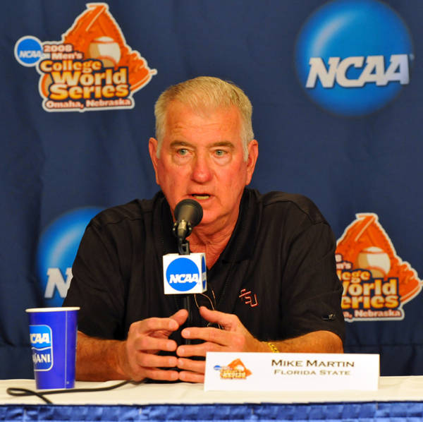 Head coach Mike Martin makes an opening statment at the coaches' press conference.