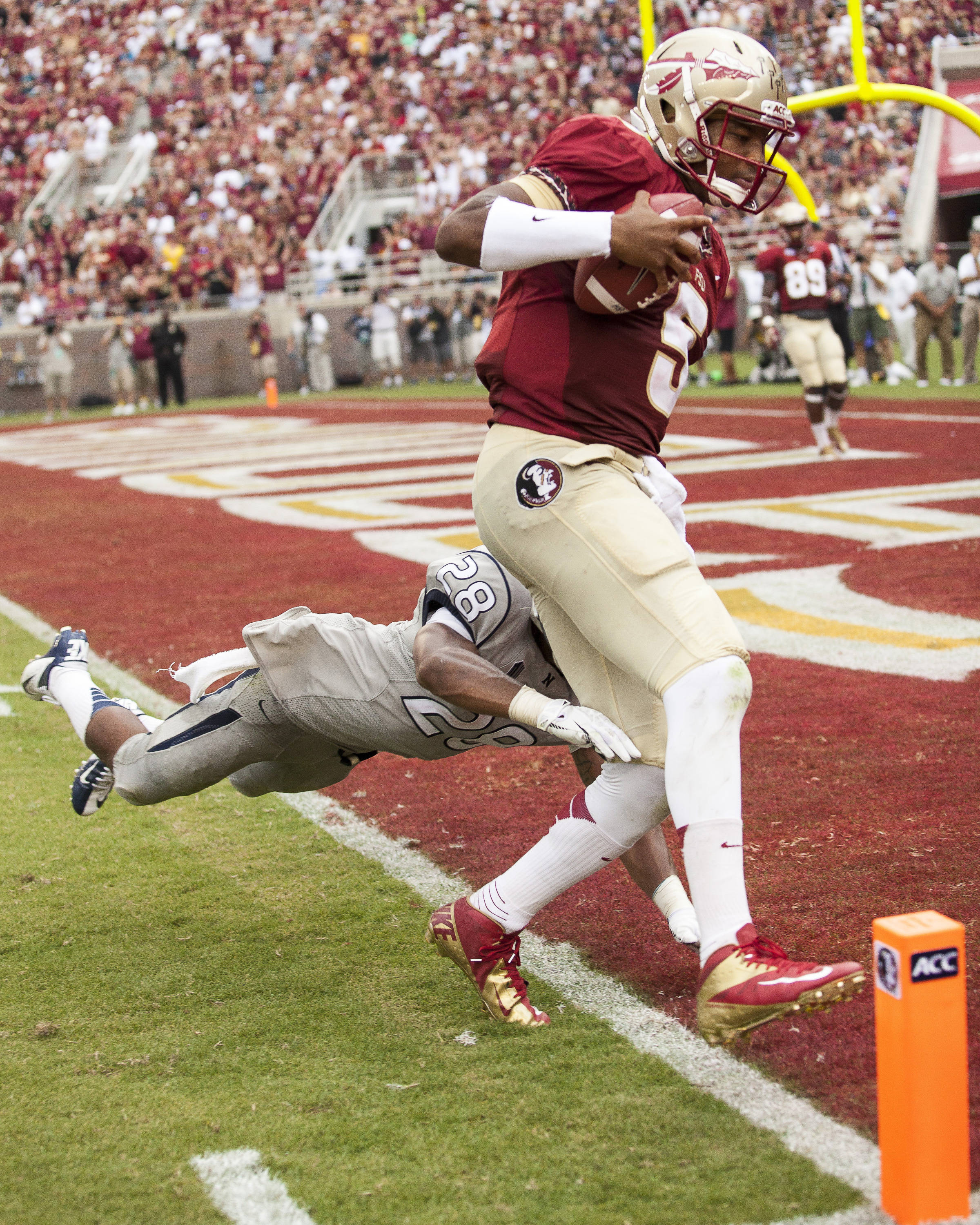 Jameis Winston (5) runs in a touchdown during FSU's 62-7 win over Nevada on Saturday, Sept 14, 2013 in Tallahassee, Fla.