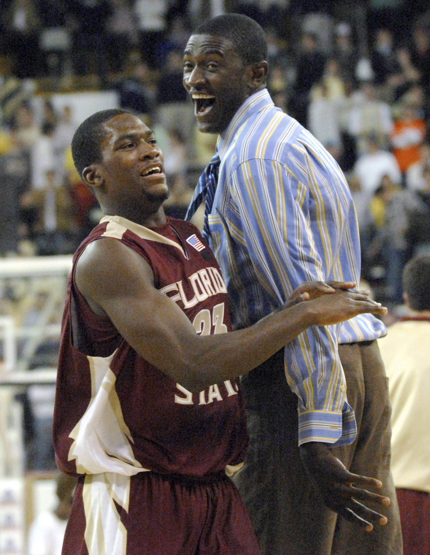 Florida State guard Toney Douglas celebrates with center Solomon Alabi after the game.