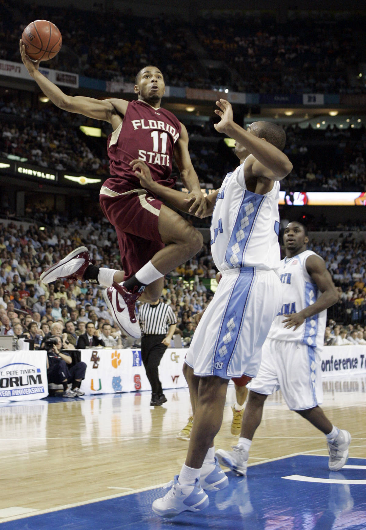Florida State's Jerel Allen (11) leaps for a shot over North Carolina's Reyshawn Terry during a second round game of the Men's Atlantic Coast Conference basketball tournament in Tampa, Fla., Friday, March 9, 2007. (AP Photo/David J. Phillip)