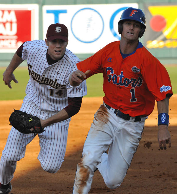 Ryan Strauss tags out Avery Barnes in run down between second and third.