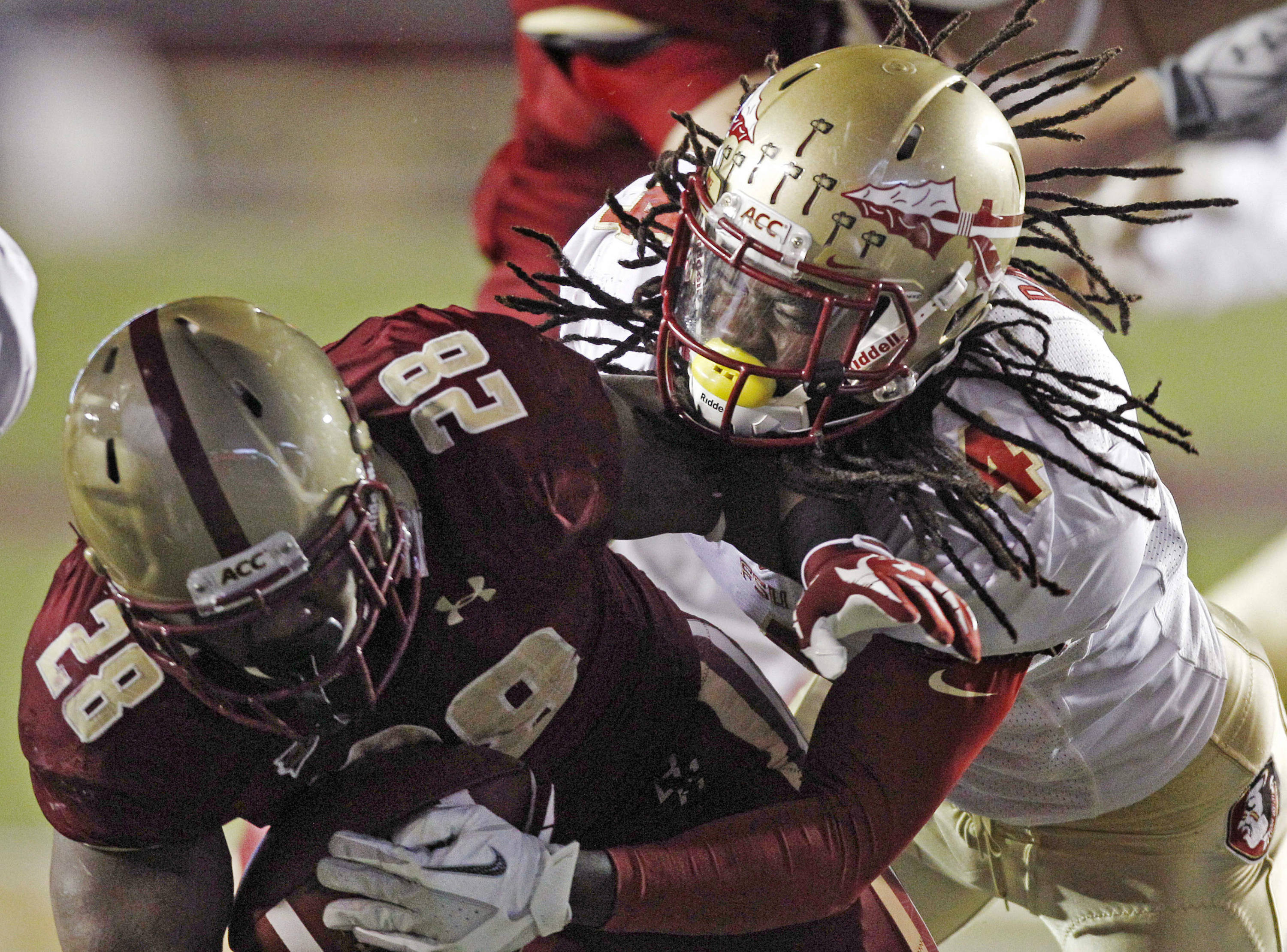 Florida State safety Terrence Parks, right, tries to strip the ball from the hands of Boston College running back Roland Finch (28) during the second half. (AP Photo/Charles Krupa)