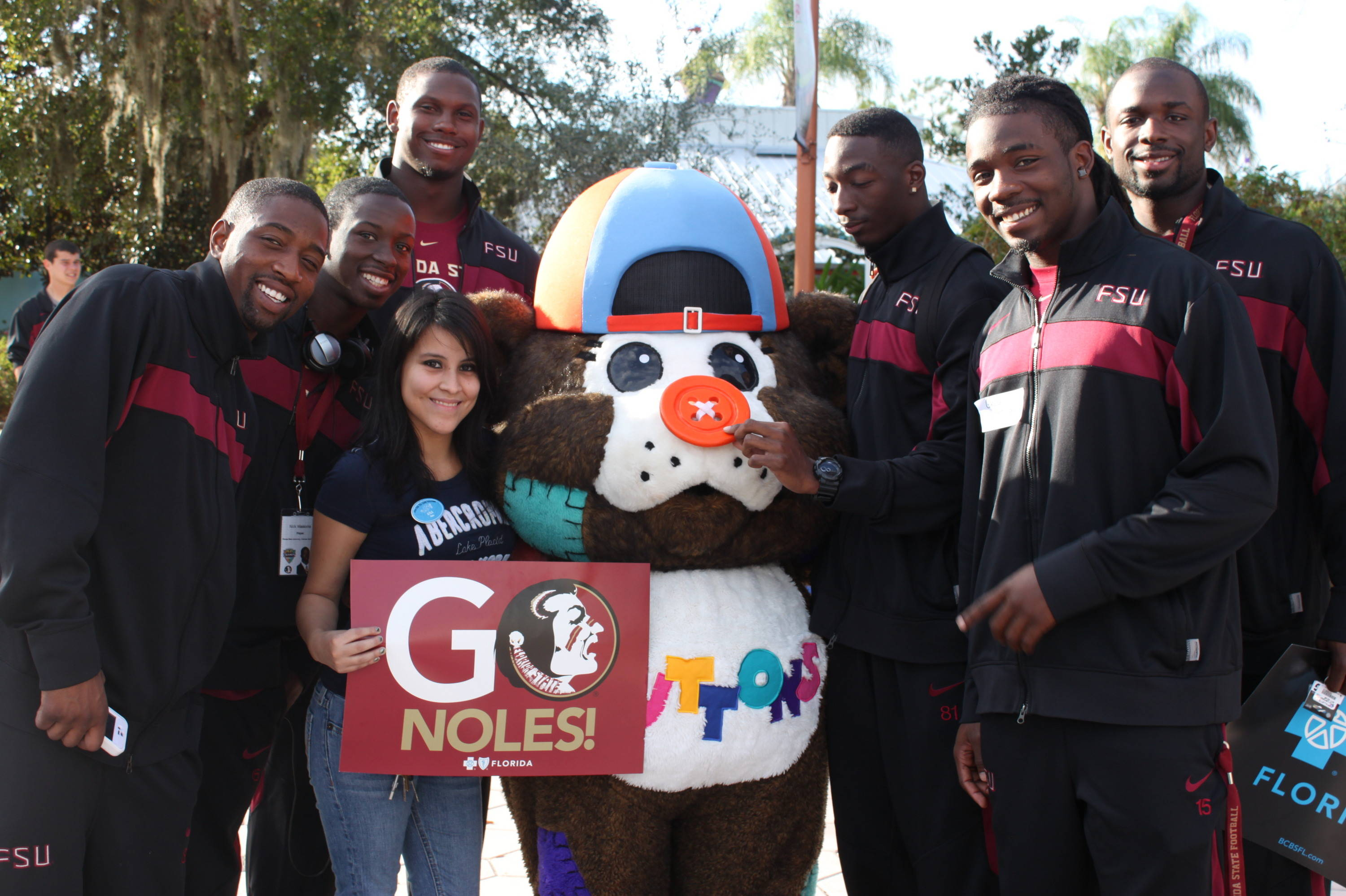 The Seminoles found a fuzzy friend and a park volunteer to mug for the camera.