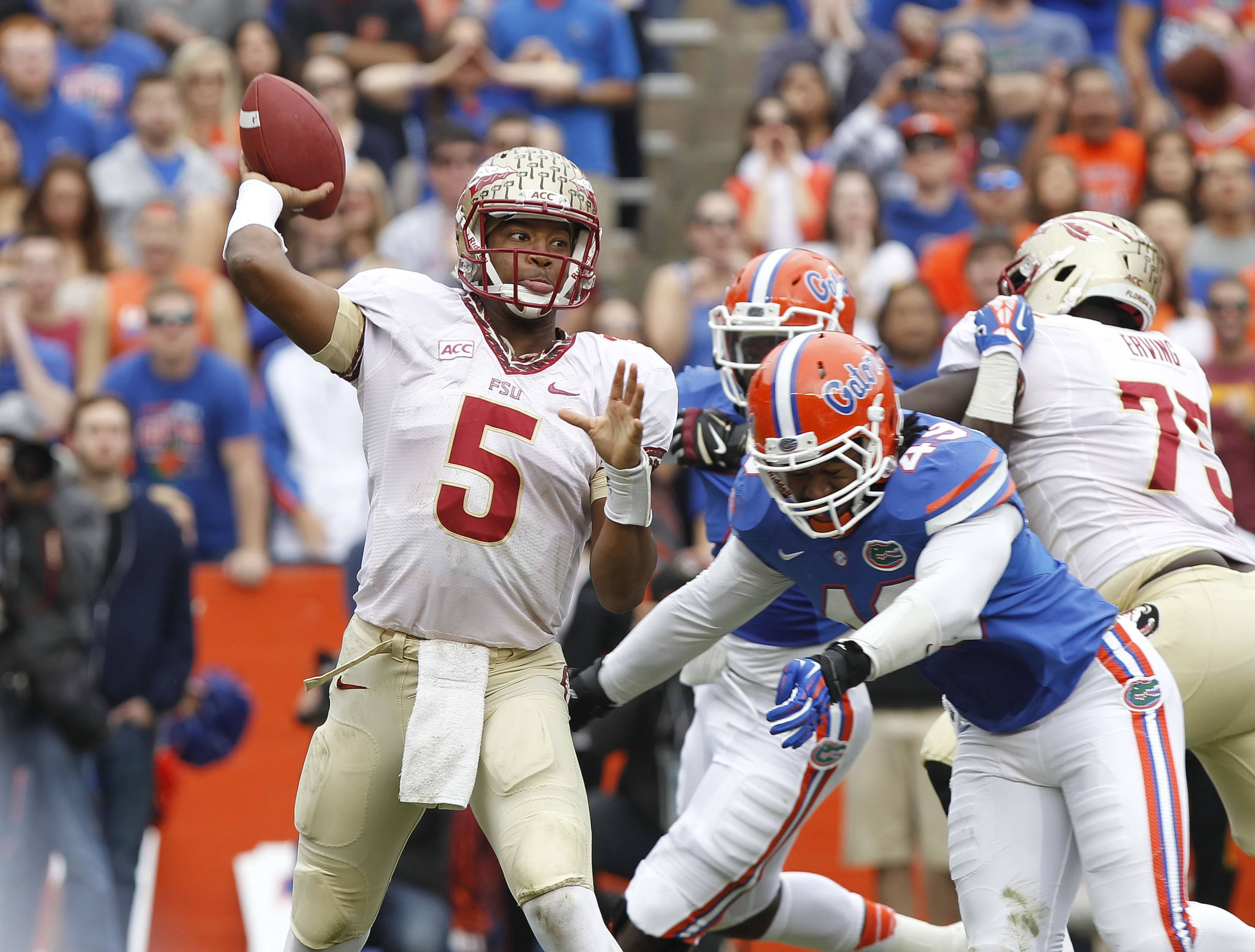 Jameis Winston (5) throws the ball. Mandatory Credit: Kim Klement-USA TODAY Sports
