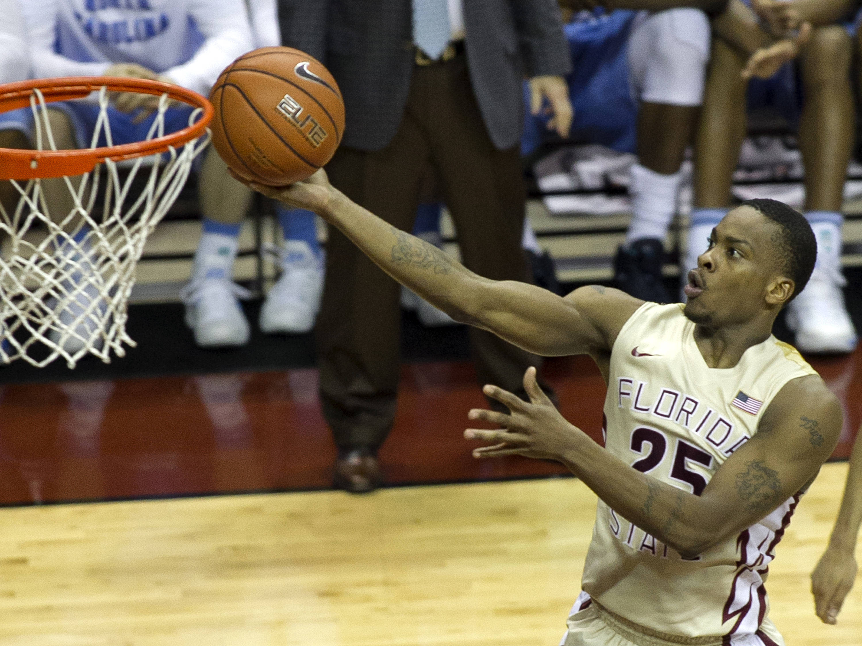 Aaron Thomas (25) reaches for his lay-up, FSU vs North Carolina, 2-17-14, (Photo's by Steve Musco)