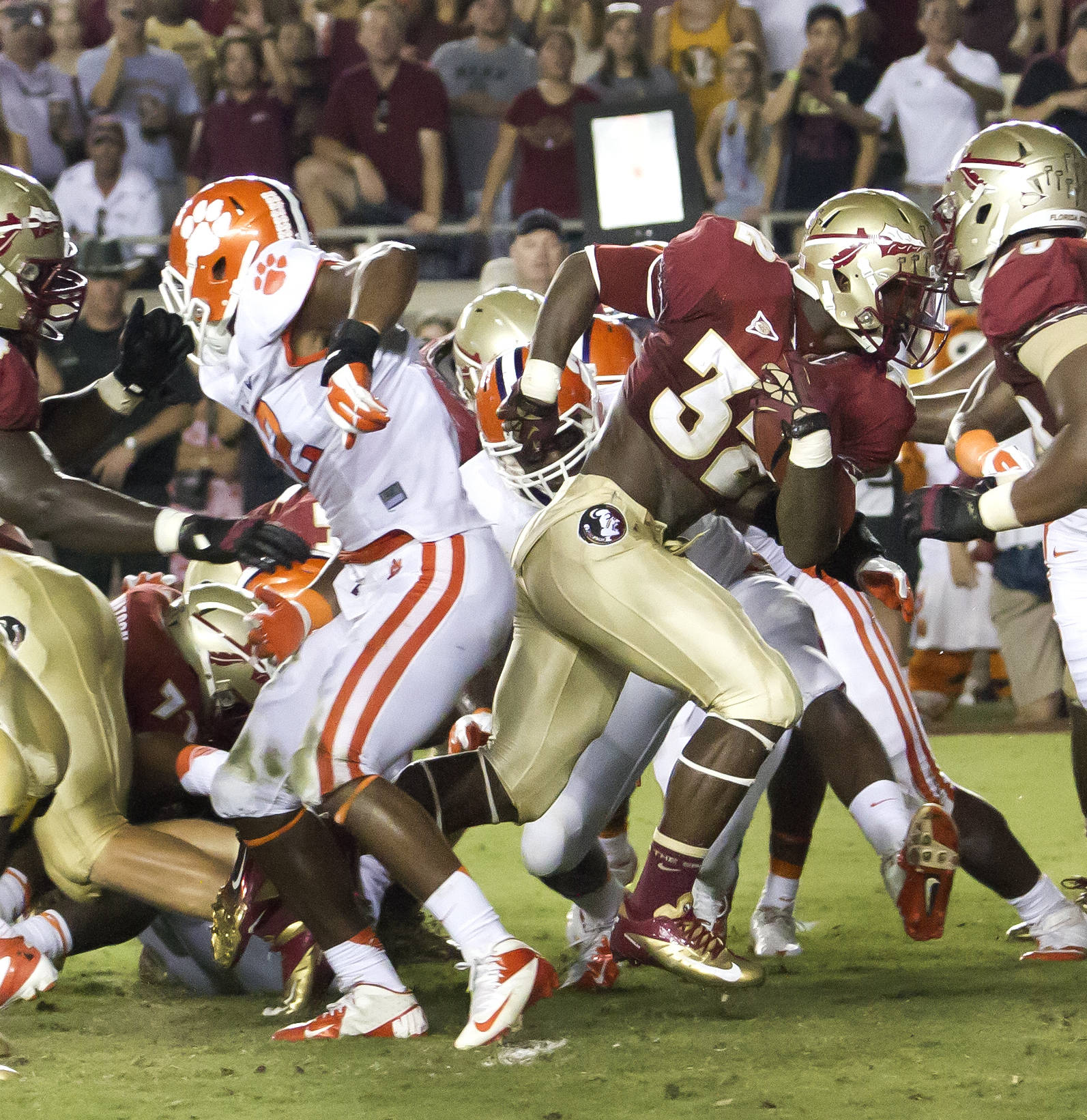 James Wilder Jr. (32) breaking thru the pack, FSU vs Clemson, 9/22/12 (Photo by Steve Musco)