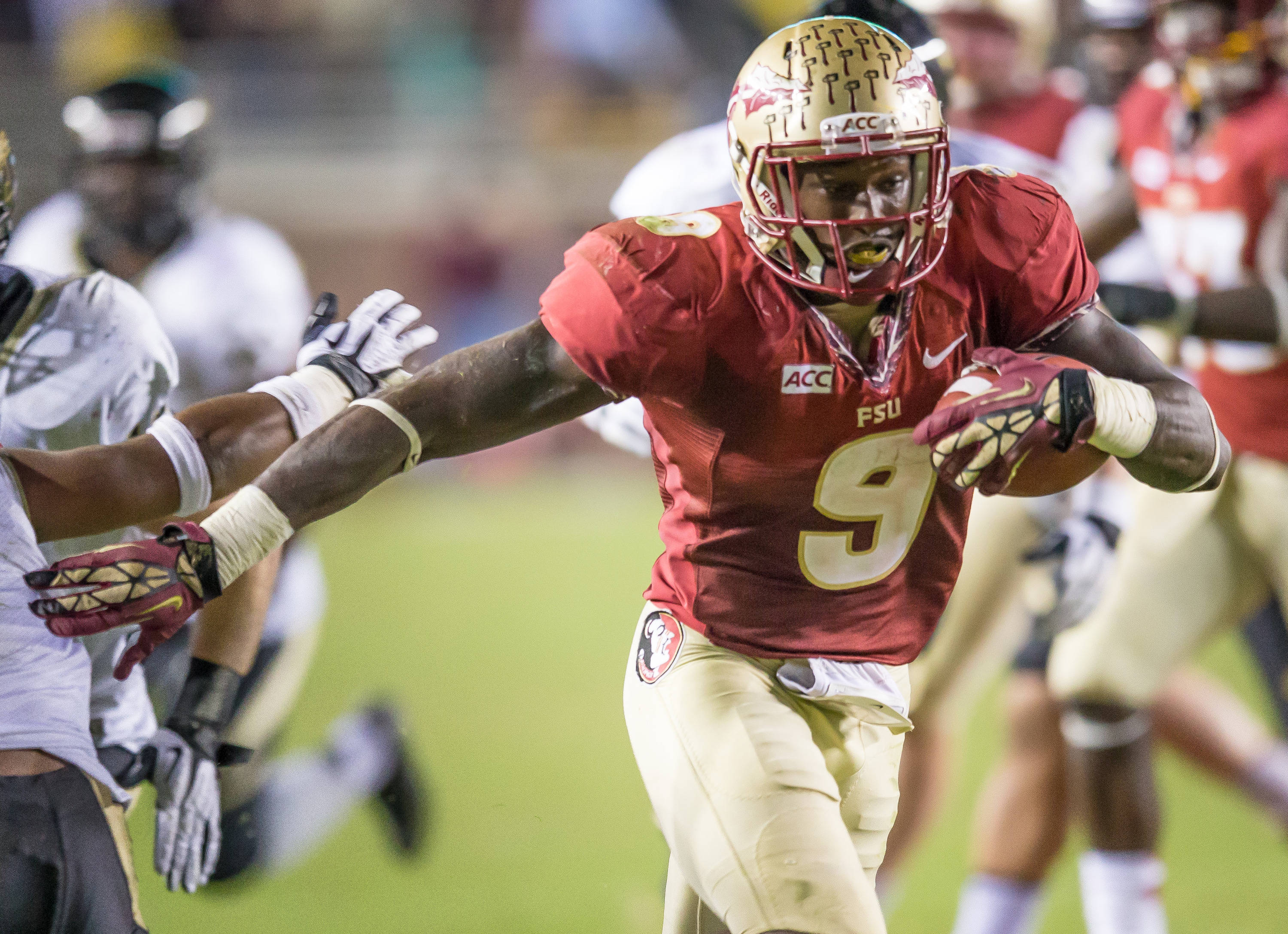 Karlos Williams (9) scored twice and rushed for 115 yards.
