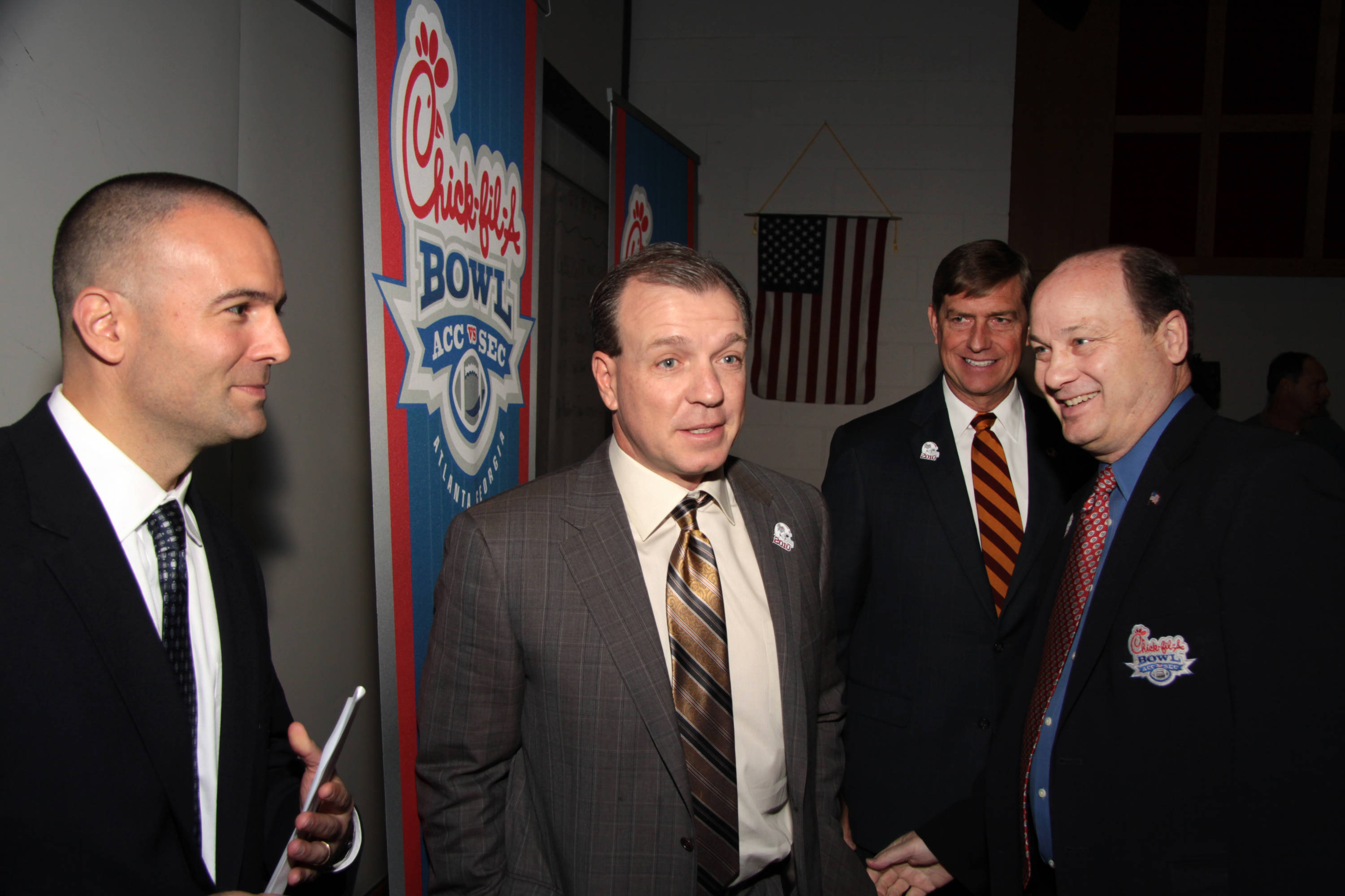 Jimbo Fisher talks with Chick-fil-A executives after the press conference.