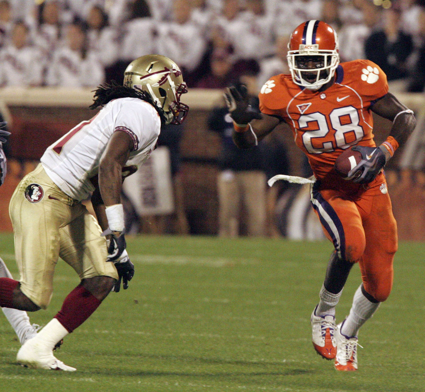 Clemson's C.J.Spiller (28) runs for a first down as Florida State's Patrick Robinson (21) defends during the first half. (AP Photo/Mary Ann Chastain)