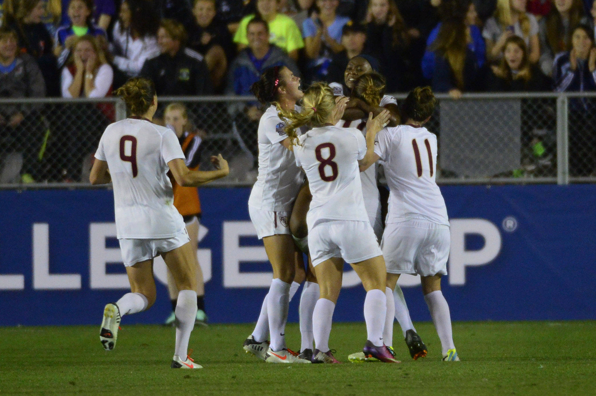 Dec 6, 2013; Cary, NC, USA; Florida State Seminoles defender Kassey Kallman (9) and defender Carson Pickett (16) and midfielder Michaela Hahn (8) and midfielder Jamia Fields (4) and defender Kristin Grubka (13) and forward Isabella Schmid (11) celebrate after Fields second goal in the second half. The Seminoles defeated the Hokies 3-2 at WakeMed Soccer Park. Mandatory Credit: Bob Donnan-USA TODAY Sports