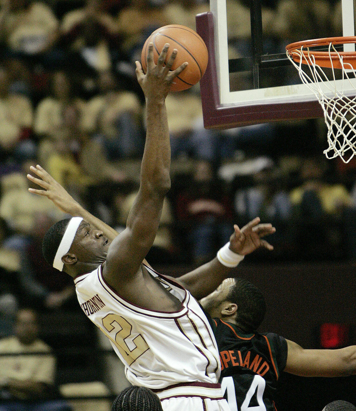 Florida State's Al Thornton, left, scores over Miami's Keaton Copeland during the second half of a college basketball game, Saturday, Jan. 20, 2007, in Tallahassee, Fla. Florida State won, 86-67. (AP Photo/Phil Coale)