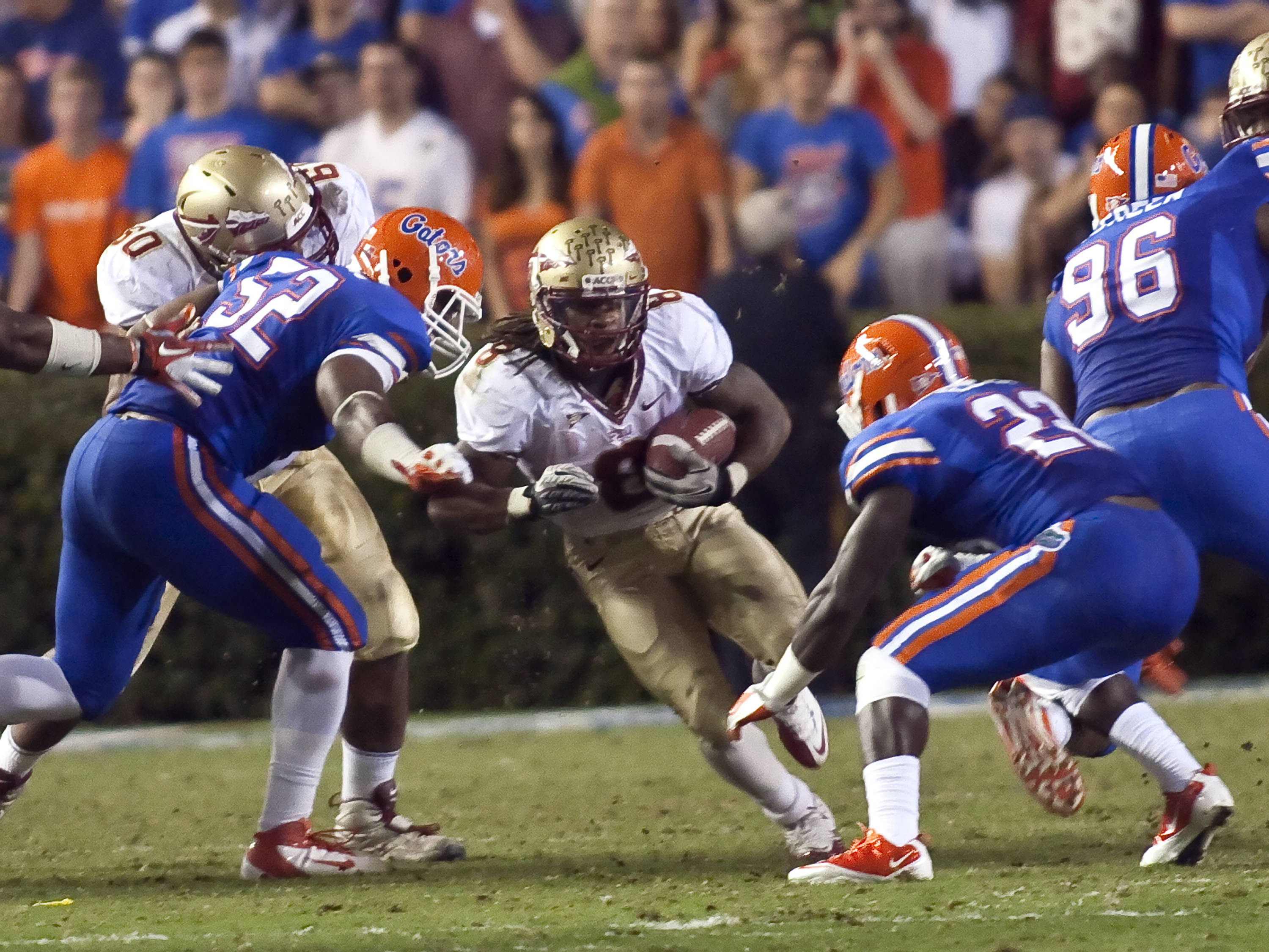 Devonta Freeman (8) running through  a large hole, FSU vs Florida, 11/26/2011