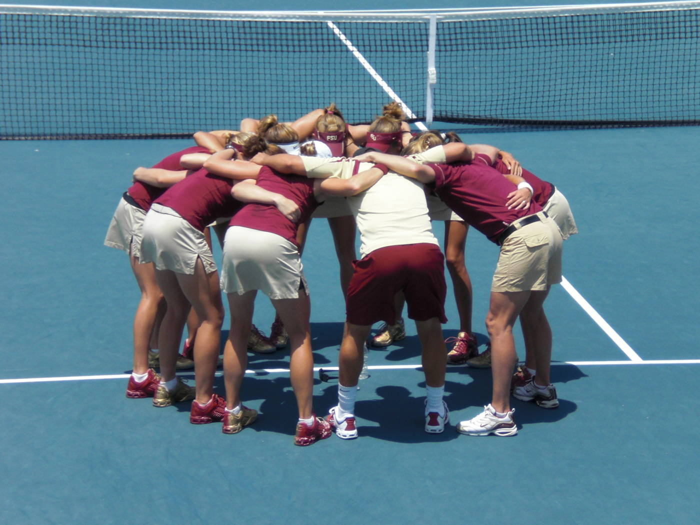 The women's tennis team prepares for a match.