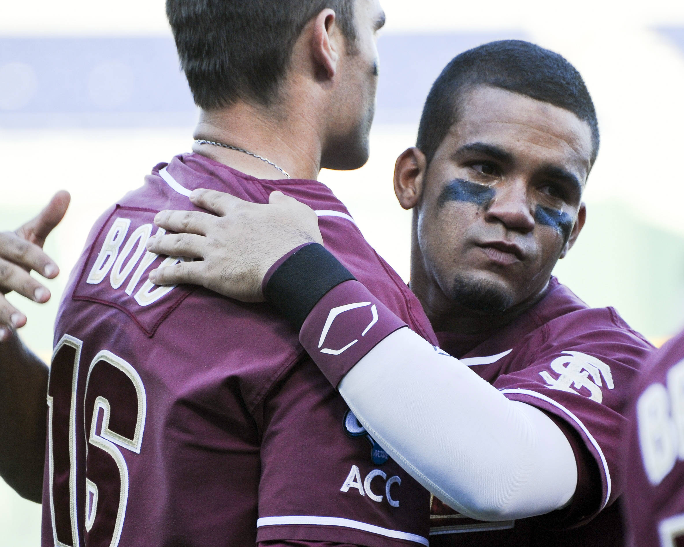 A crying Florida State's Devon Travis, right, hugs teammate Jayce Boyd, left, following an NCAA College World Series baseball game against Arizona. Arizona defeated Florida State 10-3. (AP Photo/Dave Weaver) (AP Photo/Eric Francis)