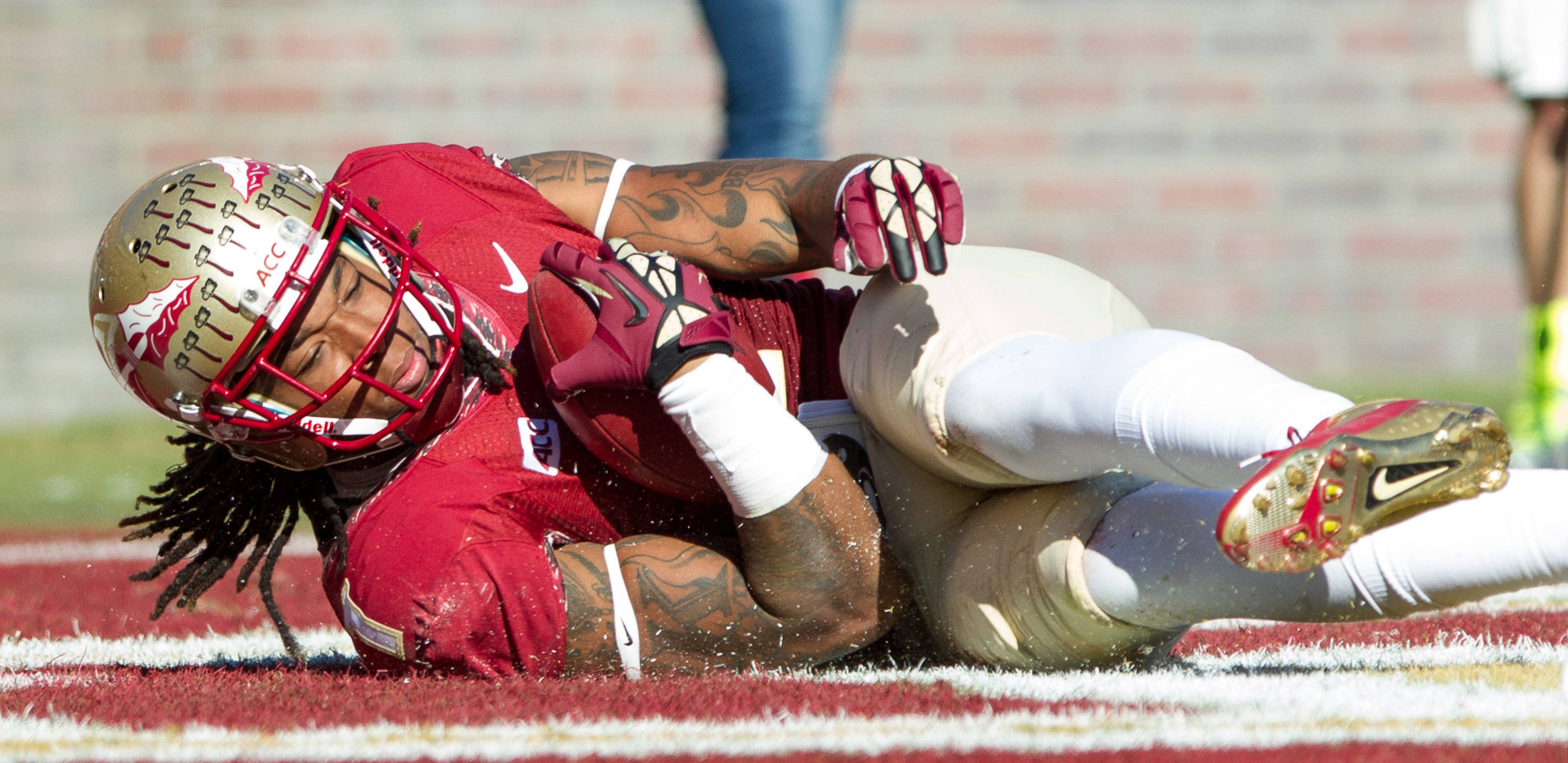 Kelvin Benjamin (1) dives in to the end zone during FSU Football's 49-17 win over NC State on Saturday, October 26, 2013 in Tallahassee, Fla. Photo by Michael Schwarz.
