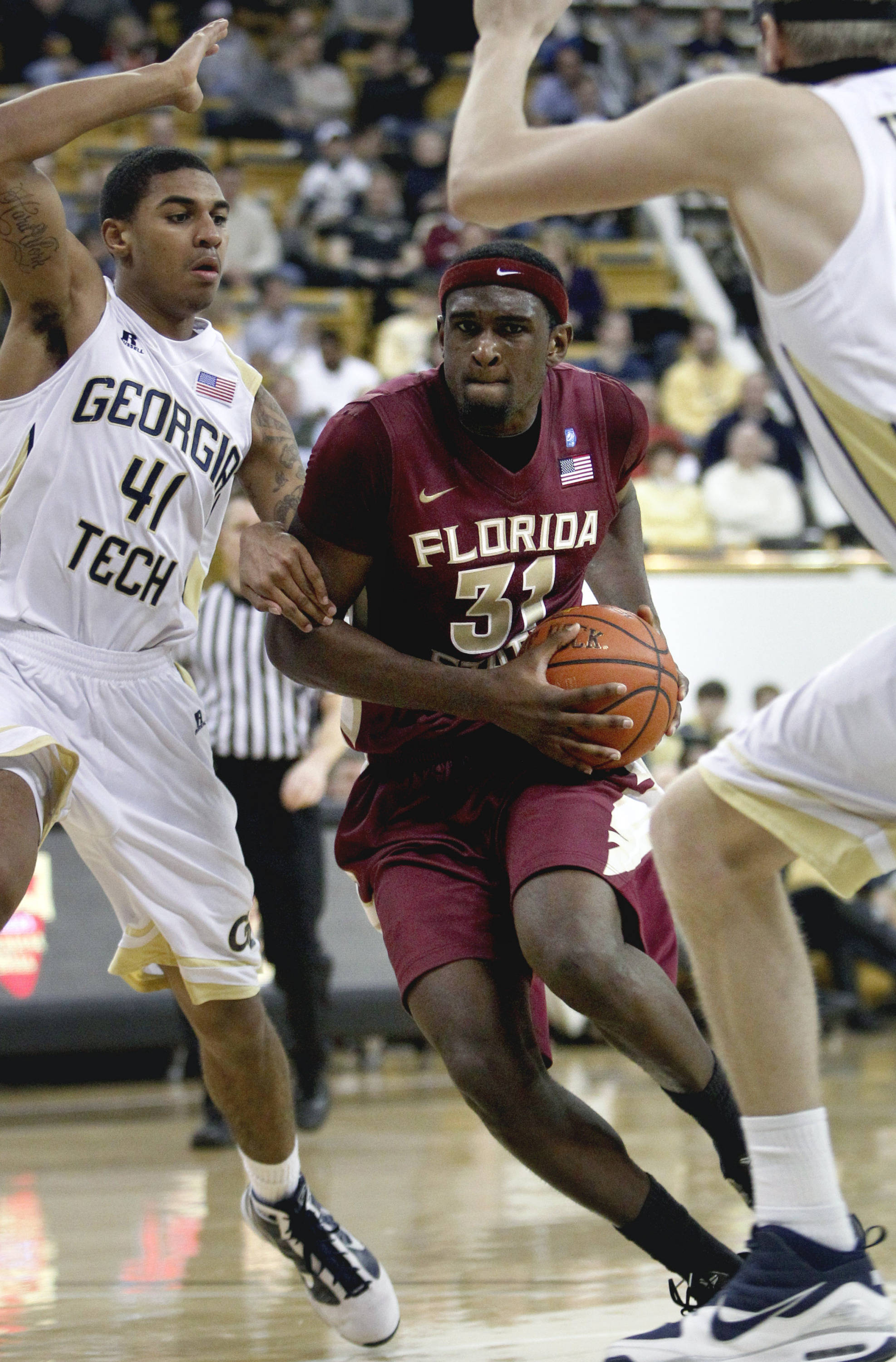 Florida State forward Chris Singleton (31) dribbles to the basket against Georgia Tech guard Glen Rice Jr. (41) during the second half. (AP Photo/David Goldman)