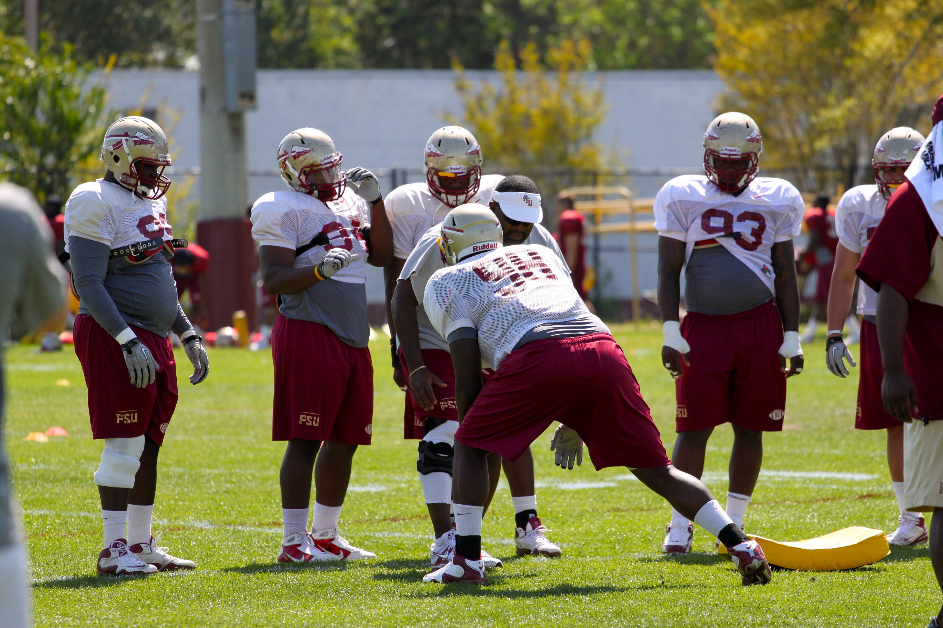 Odell Haggins works with the defensive line