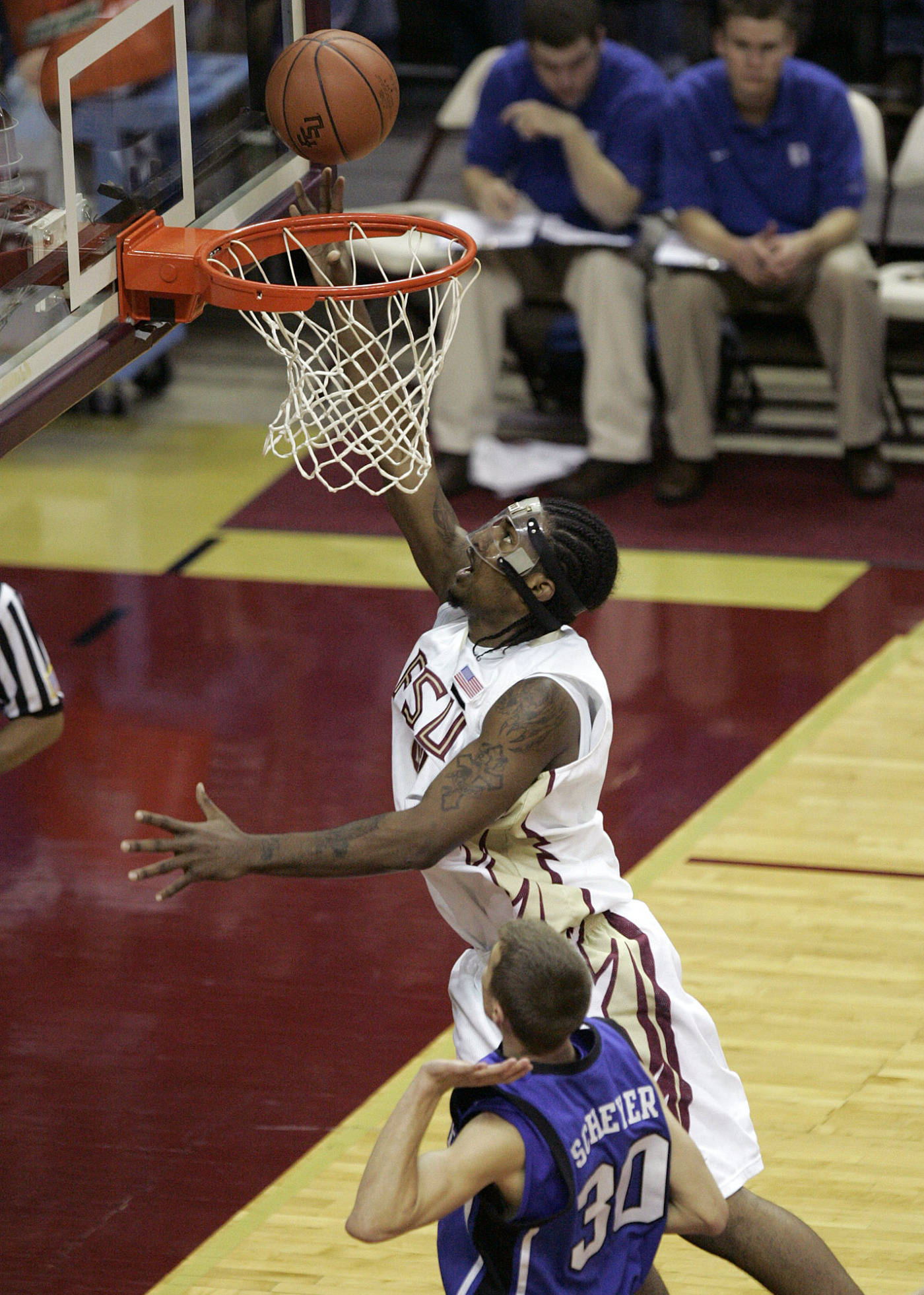 Florida State's Ryan Reid scores a basket against Duke's Jon Scheyer in the first half of a college basketball game on Wednesday, Jan. 16, 2008 in Tallahassee, Fla.