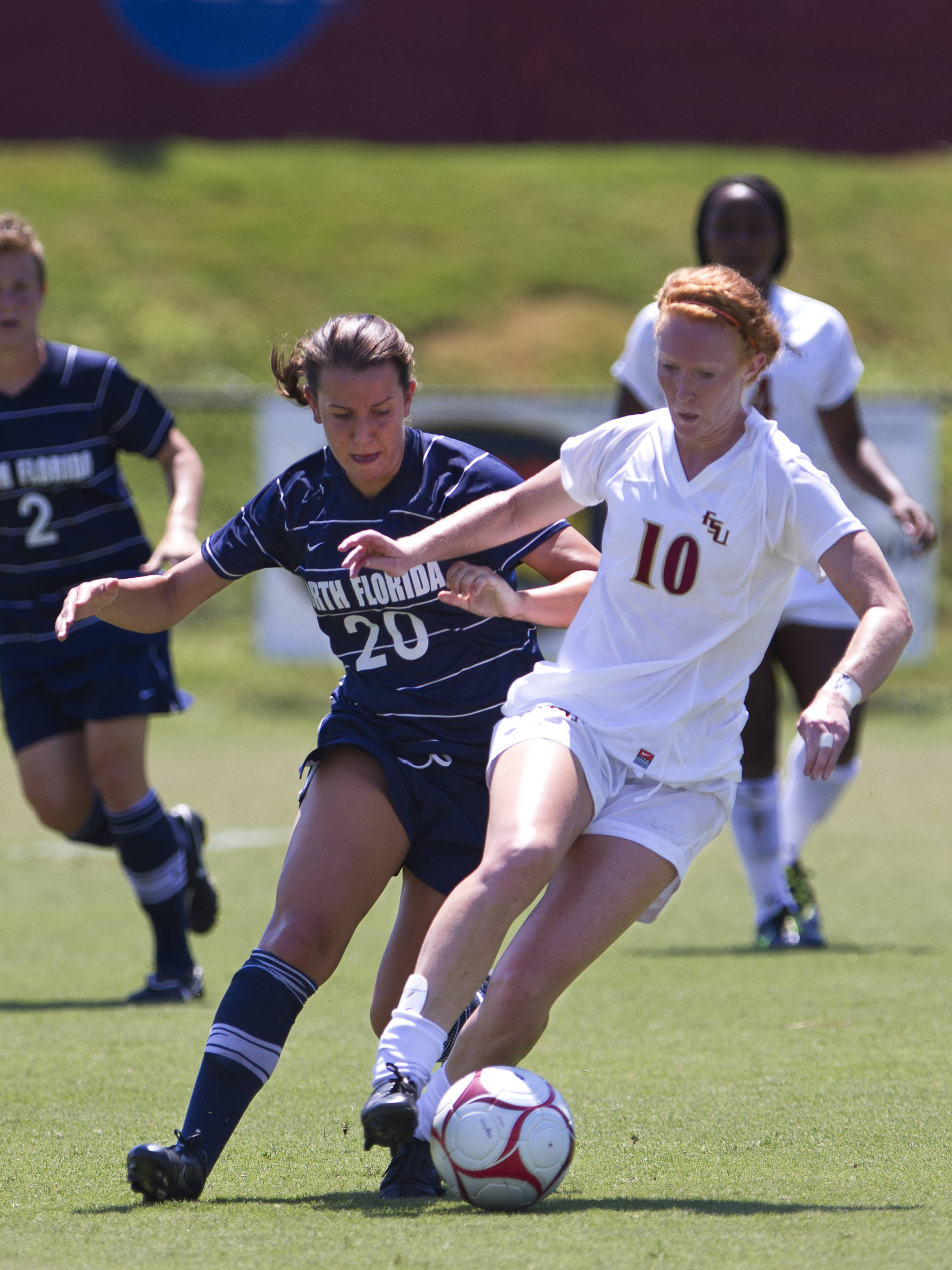 Tori Huster (10) battles a defender from North Florida in Sunday's game.