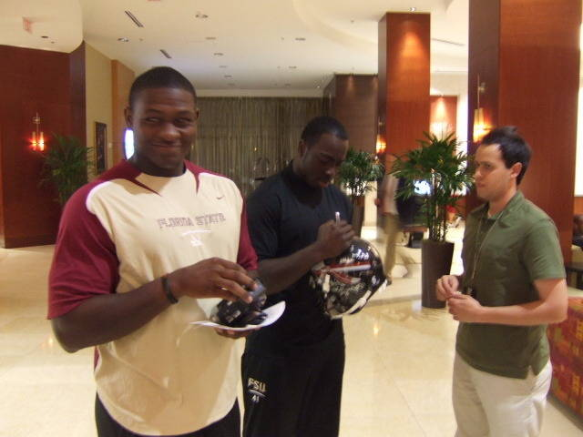 Everette Brown and Kendall Smith talking to a fan