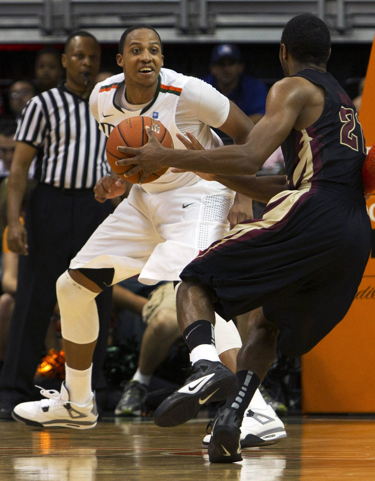 Miami's Kenny Kadji, left, forces Florida State's Michael Snaer (21) to pass the ball off during the second half of an NCAA college basketball game in Coral Gables, Fla., Sunday, Feb. 26, 2012. Miami defeated Florida State 78-62. (AP Photo/J Pat Carter)