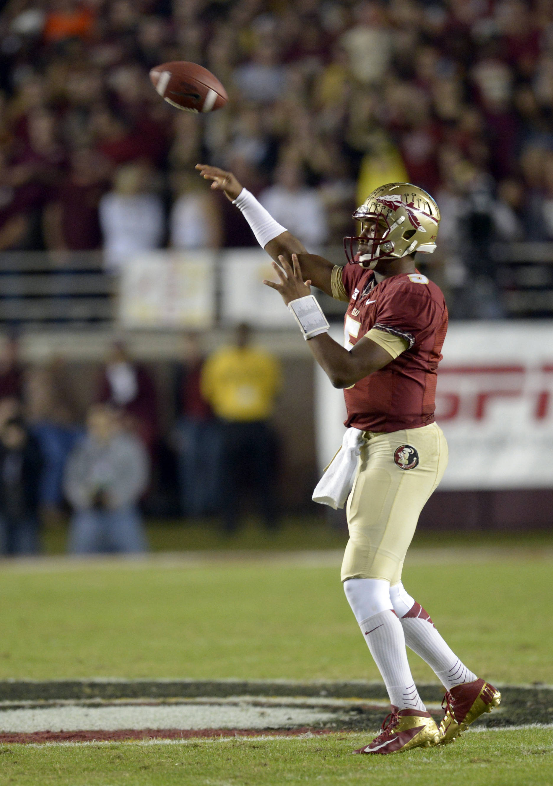Florida State Seminoles quarterback Jameis Winston (5) passes against the Miami Hurricanes during the first quarter at Doak Campbell Stadium. Mandatory Credit: John David Mercer-USA TODAY Sports