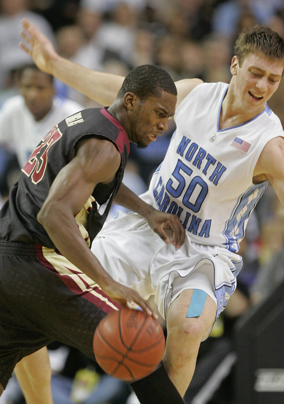 Florida State guard Toney Douglas (23) runs into North Carolina forward Tyler Hansbrough (50) in second half action during an NCAA college basketball game in the semifinals of the Atlantic Coast Conference men's tournament in Atlanta, Saturday, March 14, 2009. (AP Photo/Dave Martin)