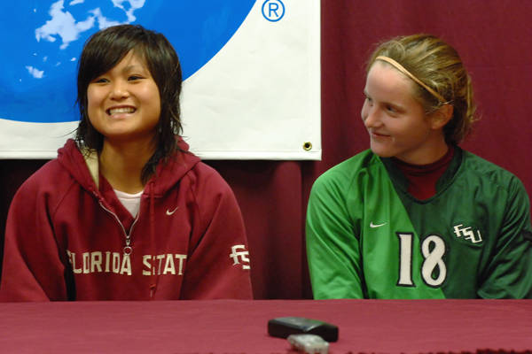 Mami Yamaguchi and Erin McNulty during the postgame press conference