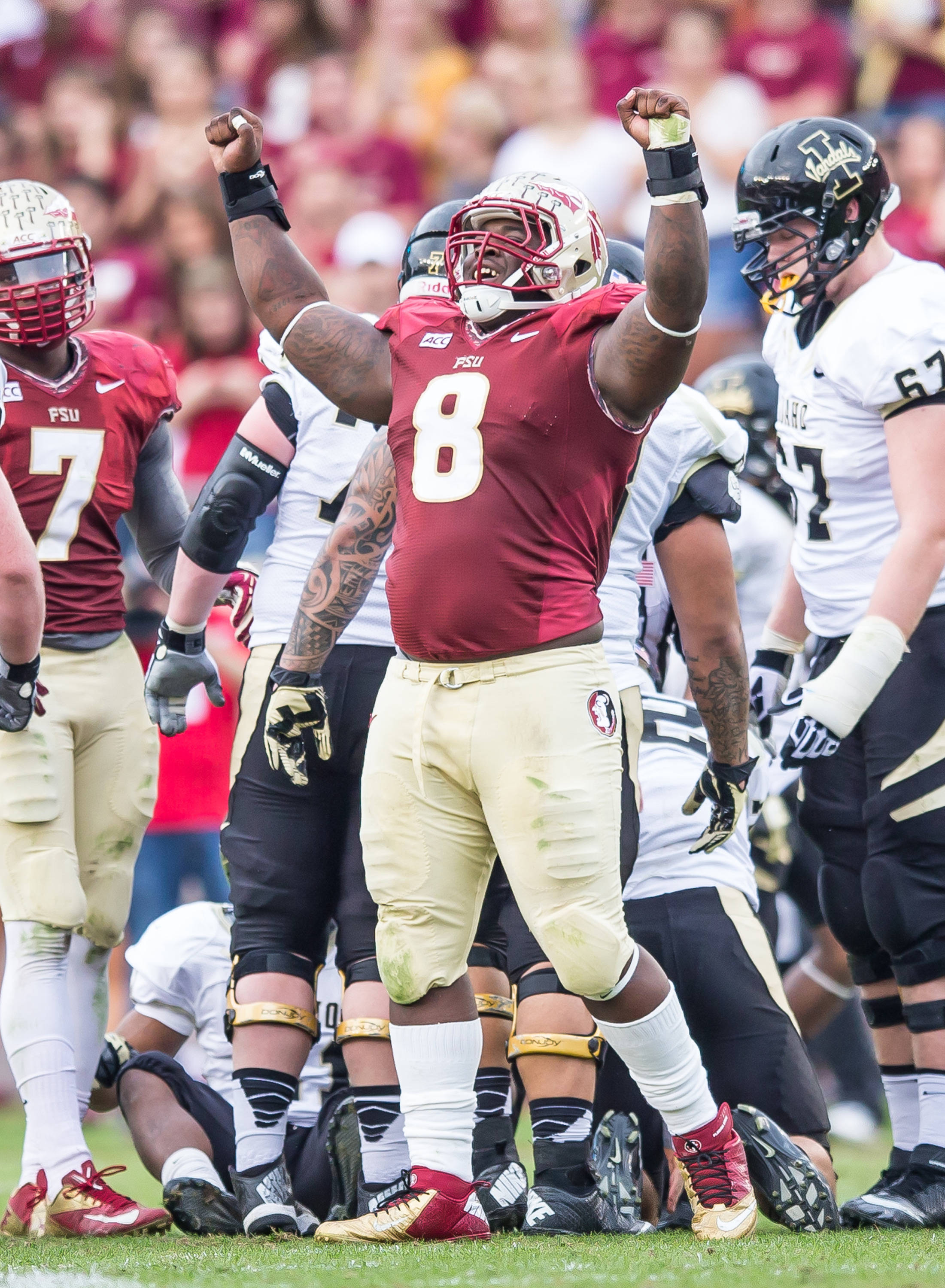 Timmy Jernigan (8) celebrates a tackle for loss