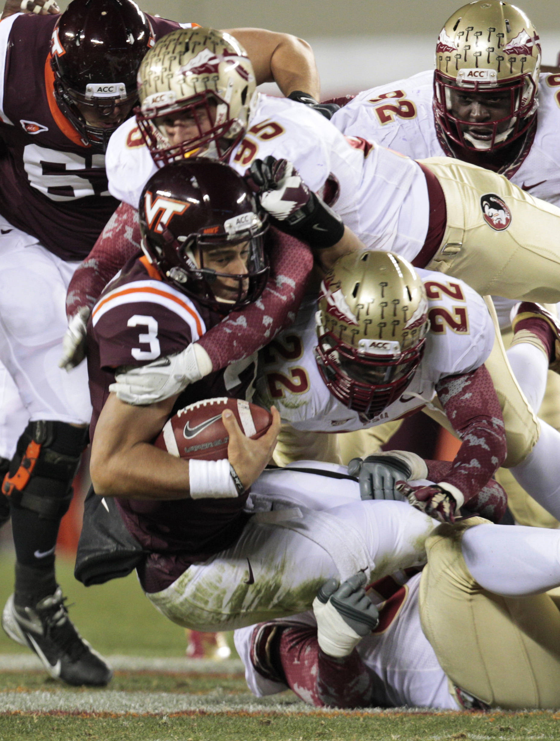 Virginia Tech quarterback Logan Thomas (3) is sacked by Florida State linebacker Telvin Smith (22) and defensive end Bjoern Werner (95). (AP Photo/Steve Helber)