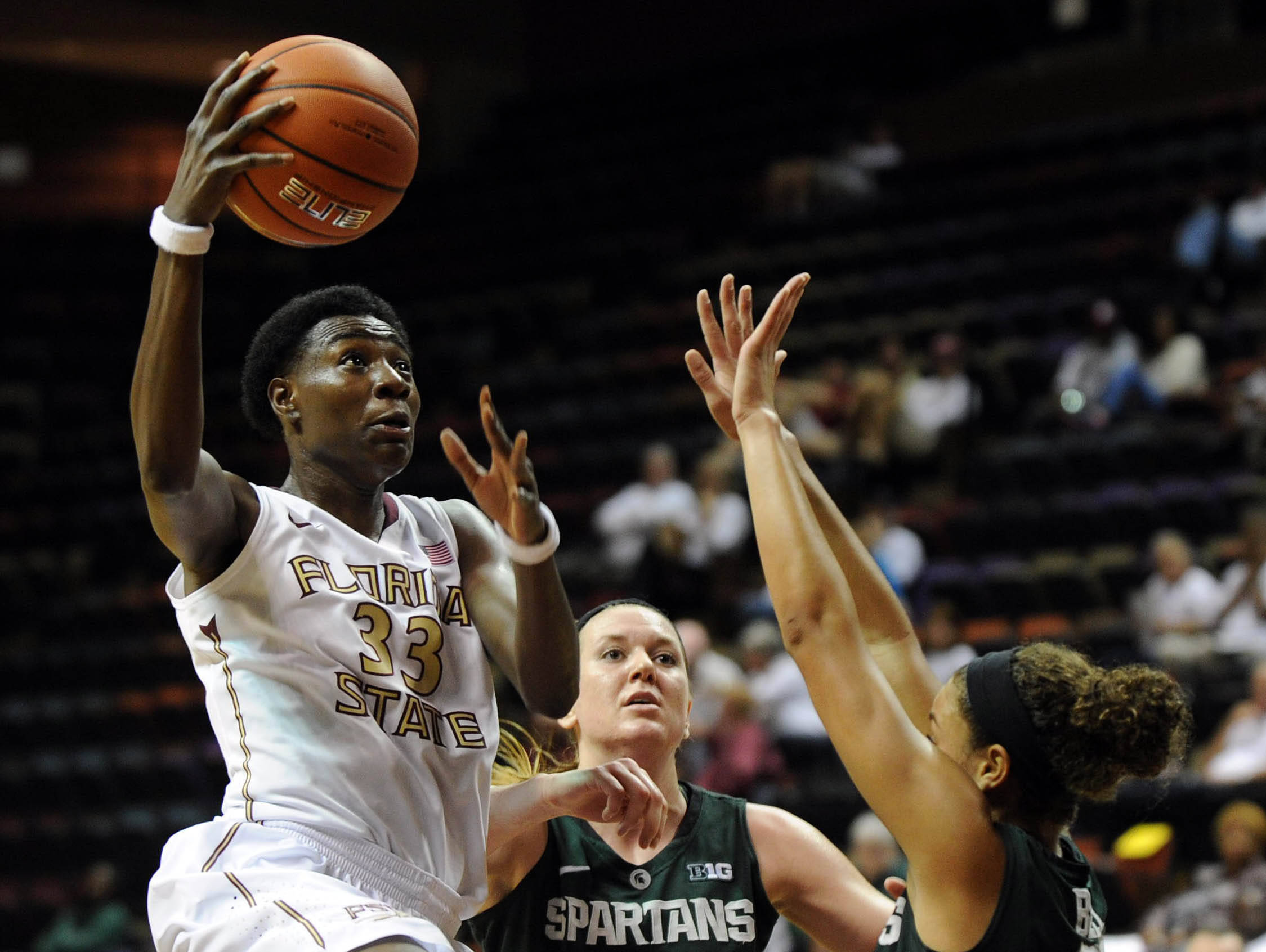 Dec 4, 2013; Tallahassee, FL, USA; Michigan State guard Klarissa Bell (21) tries to defend a shot from Florida State Seminoles forward Natasha Howard (33) during the game at the Donald L. Tucker Center (Tallahassee). Mandatory Credit: Melina Vastola-USA TODAY Sports