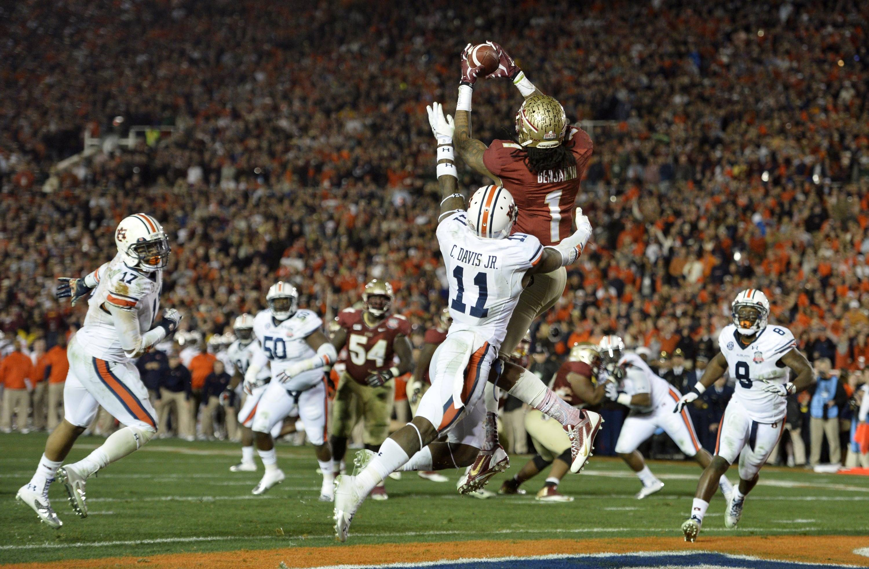 Jan 6, 2014; Pasadena, CA, USA; Florida State Seminoles wide receiver Kelvin Benjamin (1) catches a touchdown pass over Auburn Tigers cornerback Chris Davis (11) during the second half of the 2014 BCS National Championship game at the Rose Bowl.  Mandatory Credit: Robert Hanashiro-USA TODAY Sports