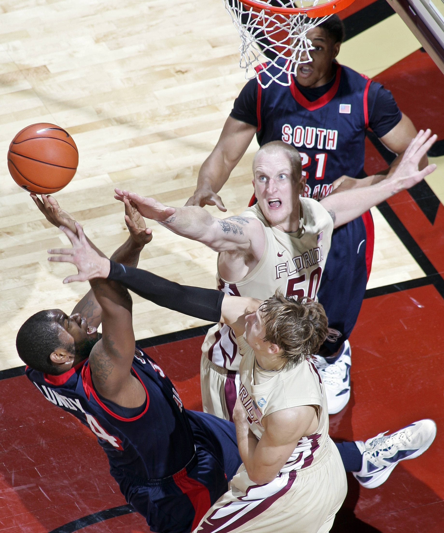 South Alabama forward Antione Lundy (34) has his shot blocked by Florida State guard Deividas Dulkys (4). (AP Photo/Phil Sears)