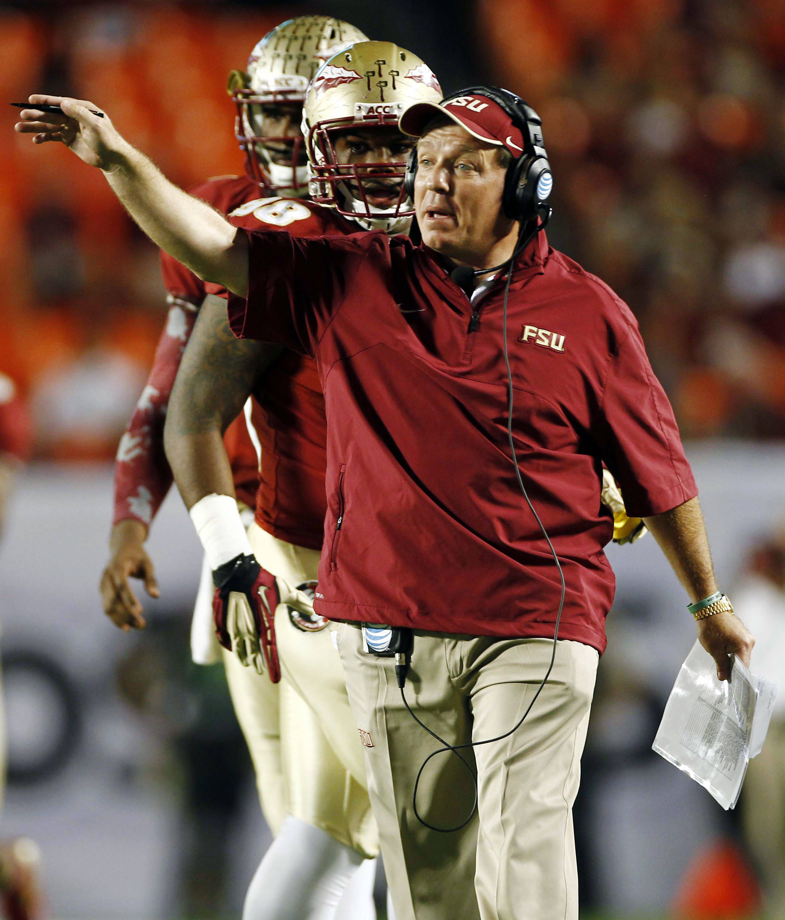 Florida State head coach Jimbo Fisher gestures during the first half of the Orange Bowl NCAA college football game against Northern Illinois, Tuesday, Jan. 1, 2013, in Miami. (AP Photo/J Pat Carter)