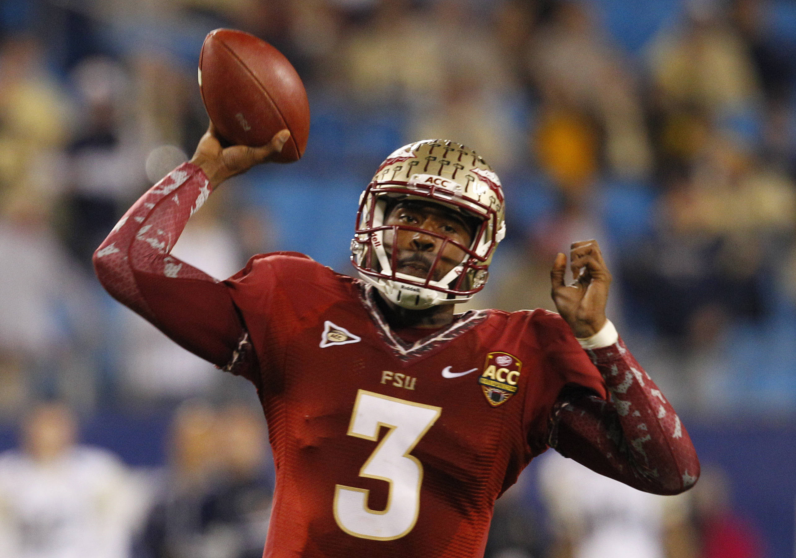 Florida State's EJ Manuel (3) throws a pass against Georgia Tech during the first half. (AP Photo/Chuck Burton)