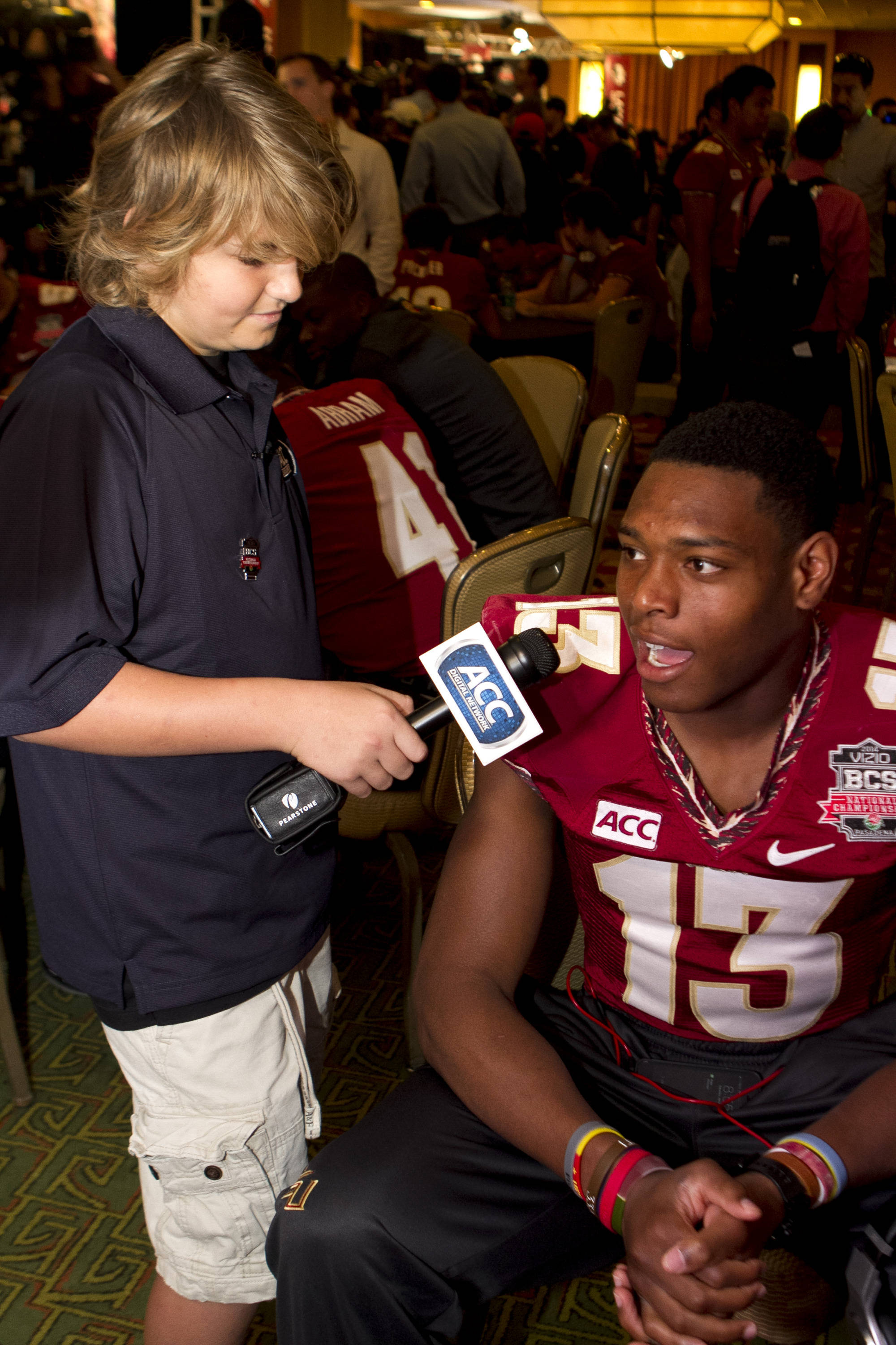 Trey Fisher interviewing Jalen Ramsey (13), FSU at BCS Championship Media Day,  1-04-14,  (Photo by Steve Musco)