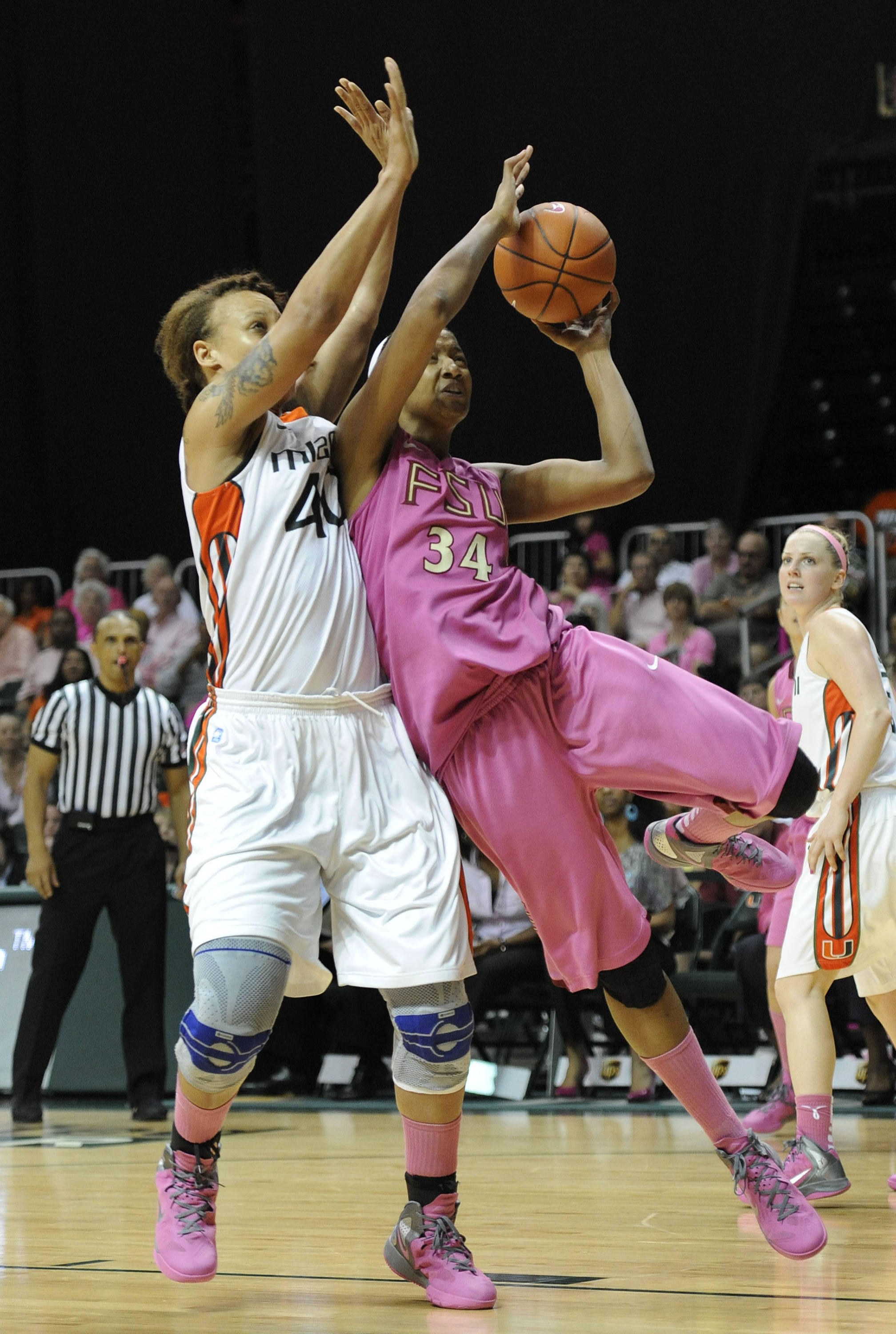 Miami's Shawnice Wilson, left, defends Florida State's Chelsea Davis, right, during the second half of an NCAA college basketball game on Sunday, Feb. 19, 2012, in Coral Gables, Fla. Miami defeated Florida State 67-60. (AP Photo/Rhona Wise)