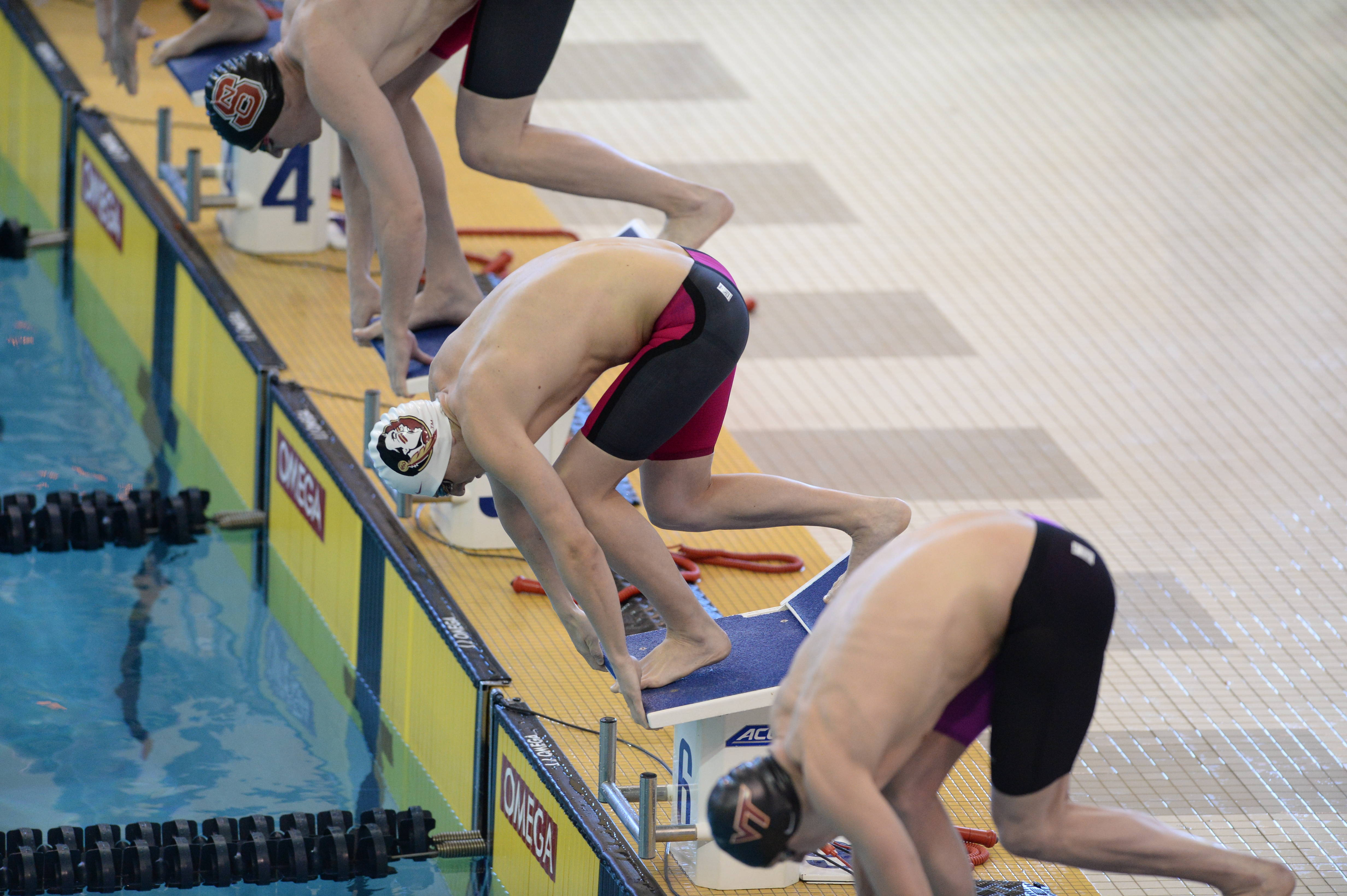 Kevin Rogers gets off the blocks in the 200 free - Mitch White