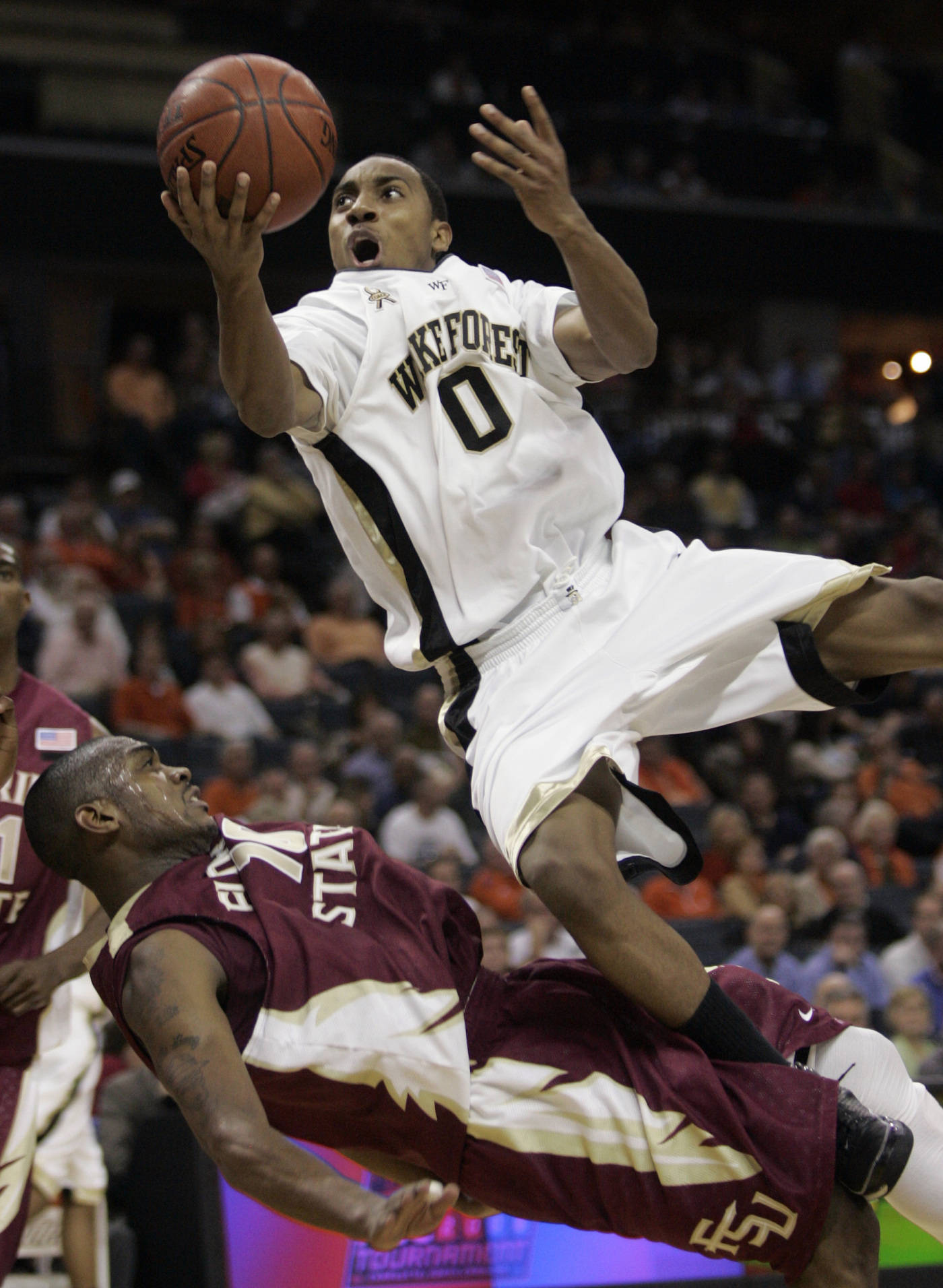 Wake Forest's Jeff Teague drives into Ralph Mims in the second half. Florida State won 70-60. (AP Photo/Steve Helber)