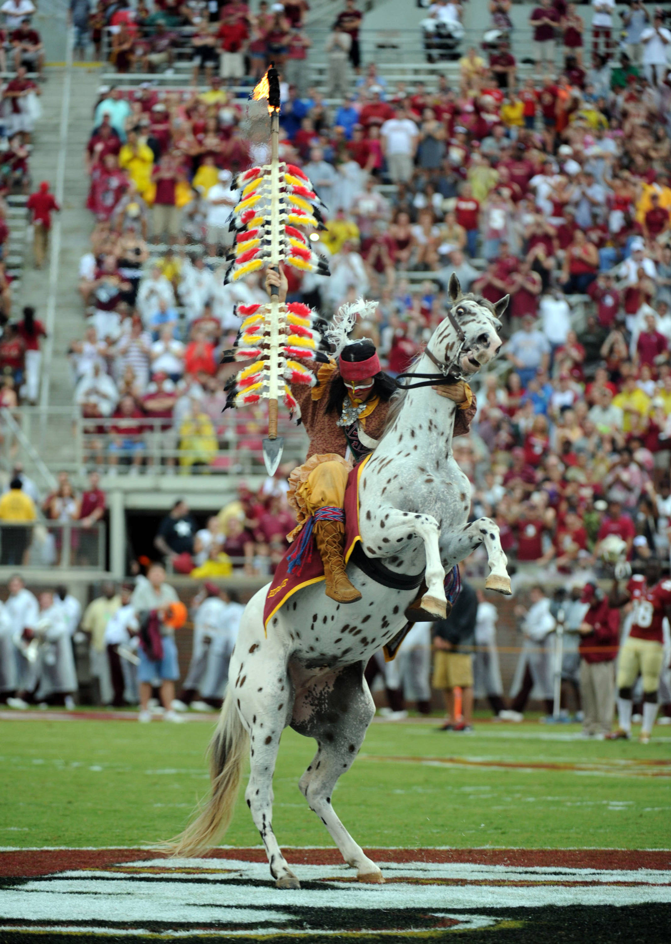 Florida State Seminoles mascot Chief Osceola spikes the spear in the middle of the field before game against the Bethune-Cookman Wildcats. (Melina Vastola-USA TODAY Sports)