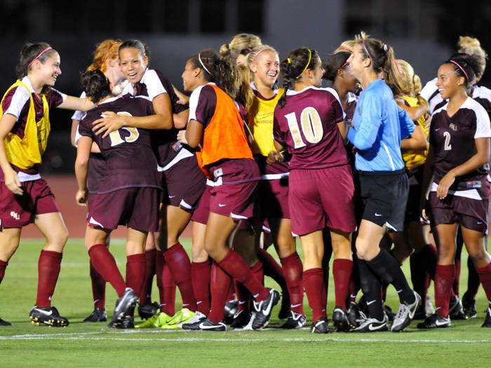 The Seminoles celebrate after Toni Pressley's golden goal in the 93rd minute.