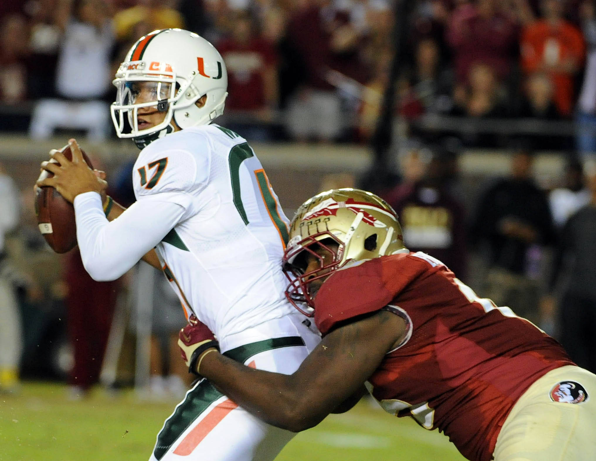 Miami Hurricanes quarterback Stephen Morris (17) is sacked by Florida State Seminoles defensive end Mario Edwards Jr. (15) during the first half at Doak Campbell Stadium. Mandatory Credit: Melina Vastola-USA TODAY Sports