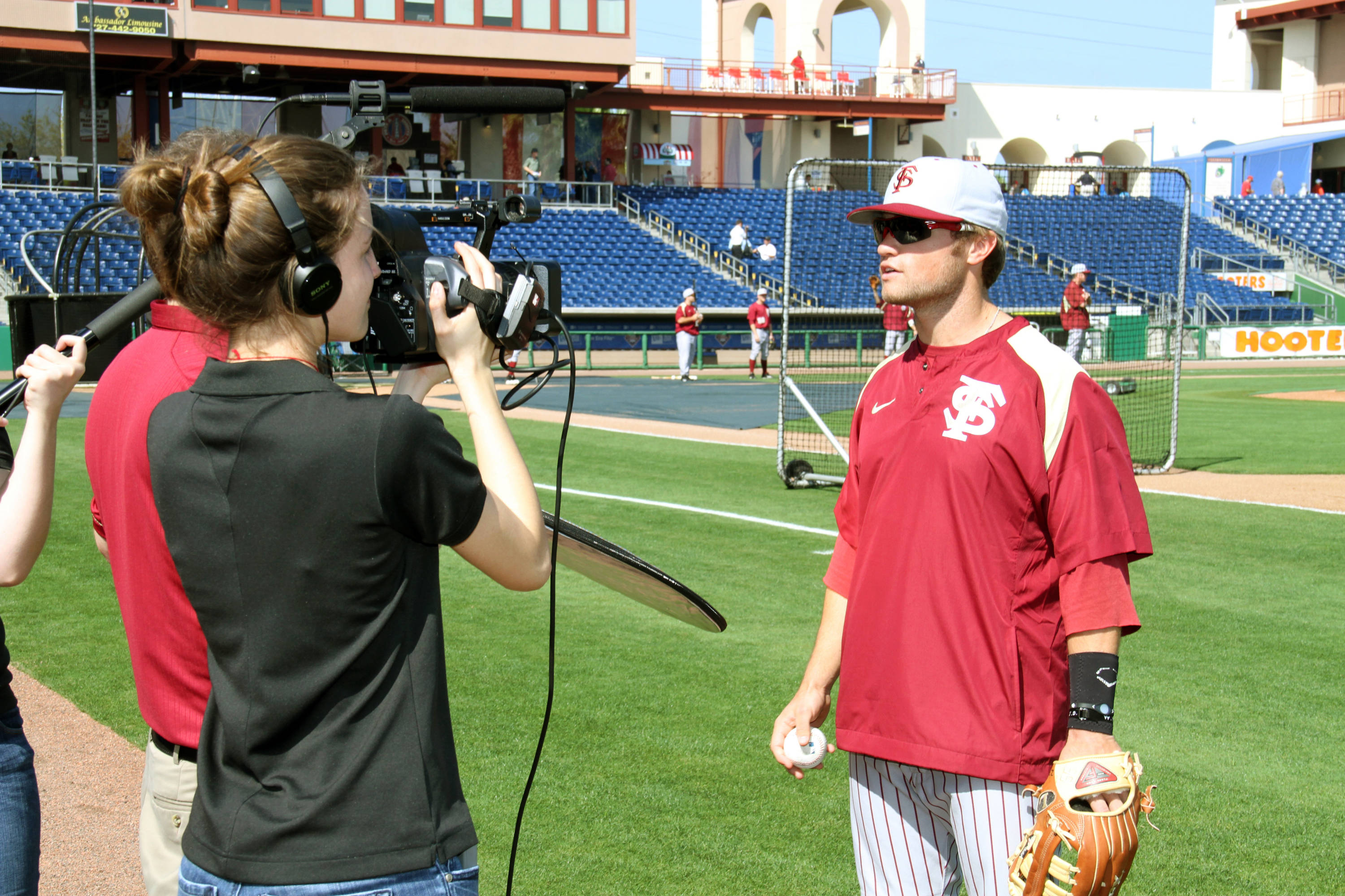 James Ramsey is interviewed by the media on the field during the game.