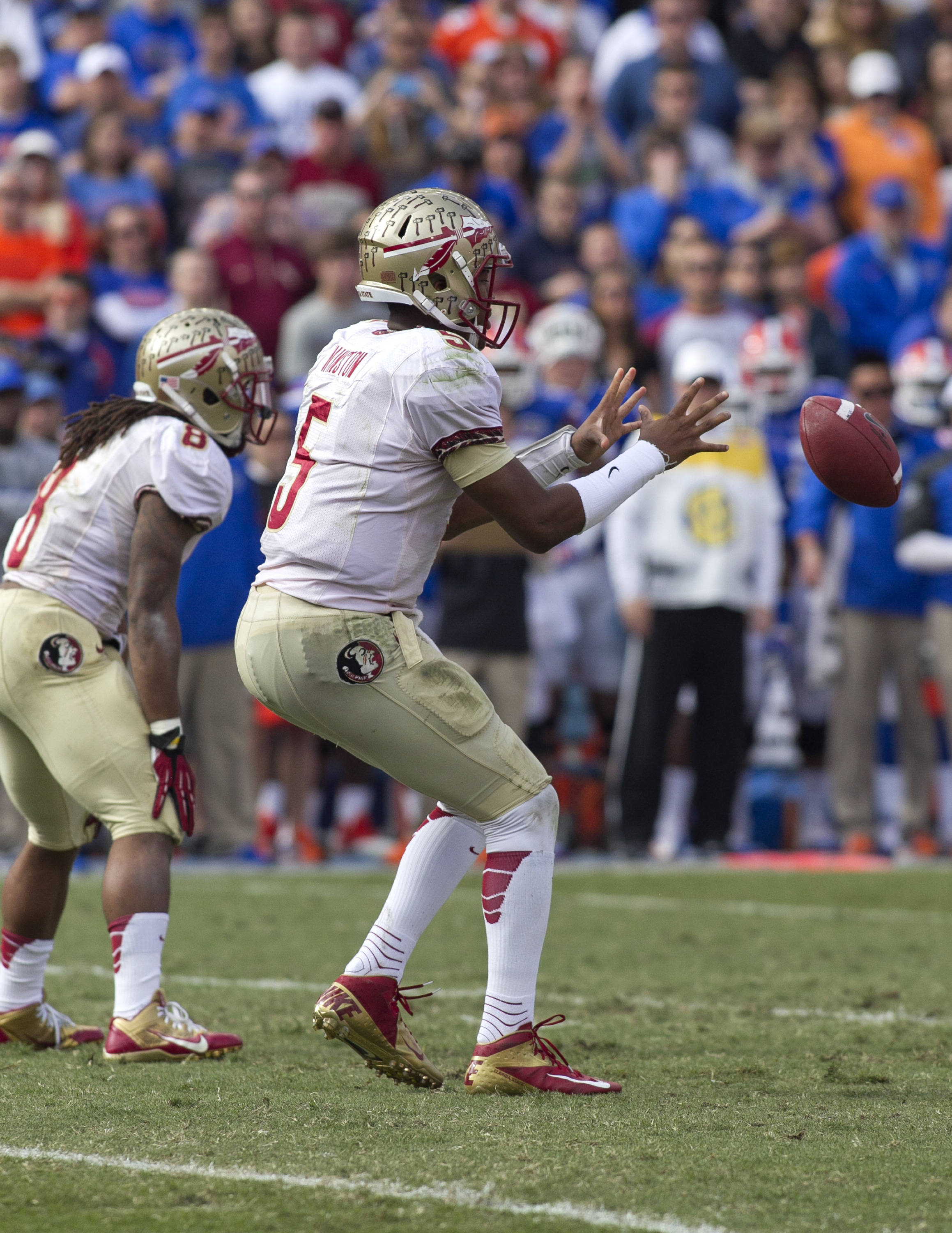 Jameis Winston (5) taking a snap, FSU vs Florida, 11-30-13,  (Photo by Steve Musco)