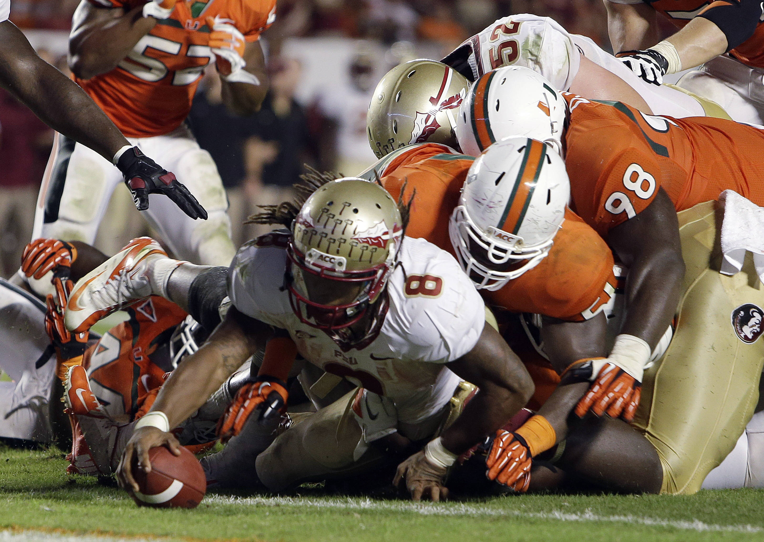 Florida State running back Devonta Freeman (8) scores a touchdown during the second half of an NCAA college football game against Miami, Saturday, Oct. 20, 2012, in Miami. (AP Photo/Lynne Sladky)