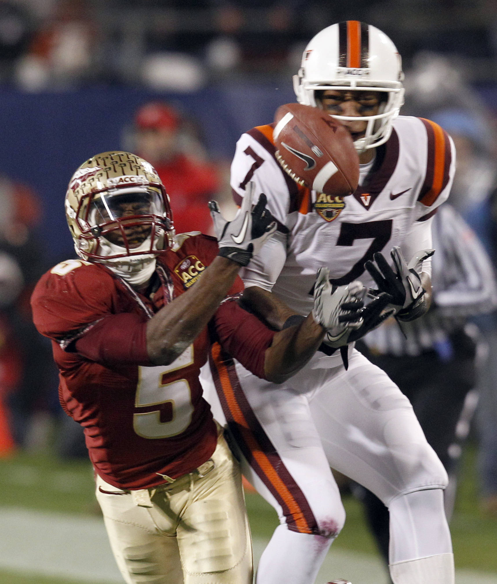 Florida State's Greg Reid knocks the ball from Virginia Tech's Marcus Davis.