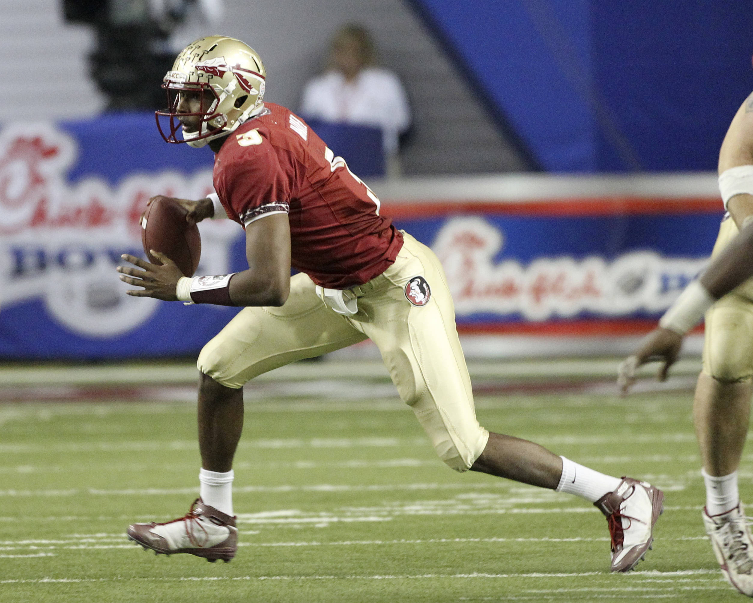 Florida State quarterback EJ Manuel (3) scrambles during the third quarter of the Chick-fil-A Bowl against South Carolina on Friday, Dec. 31, 2010, in Atlanta. Florida State won 26-17. (AP Photo/John Bazemore)