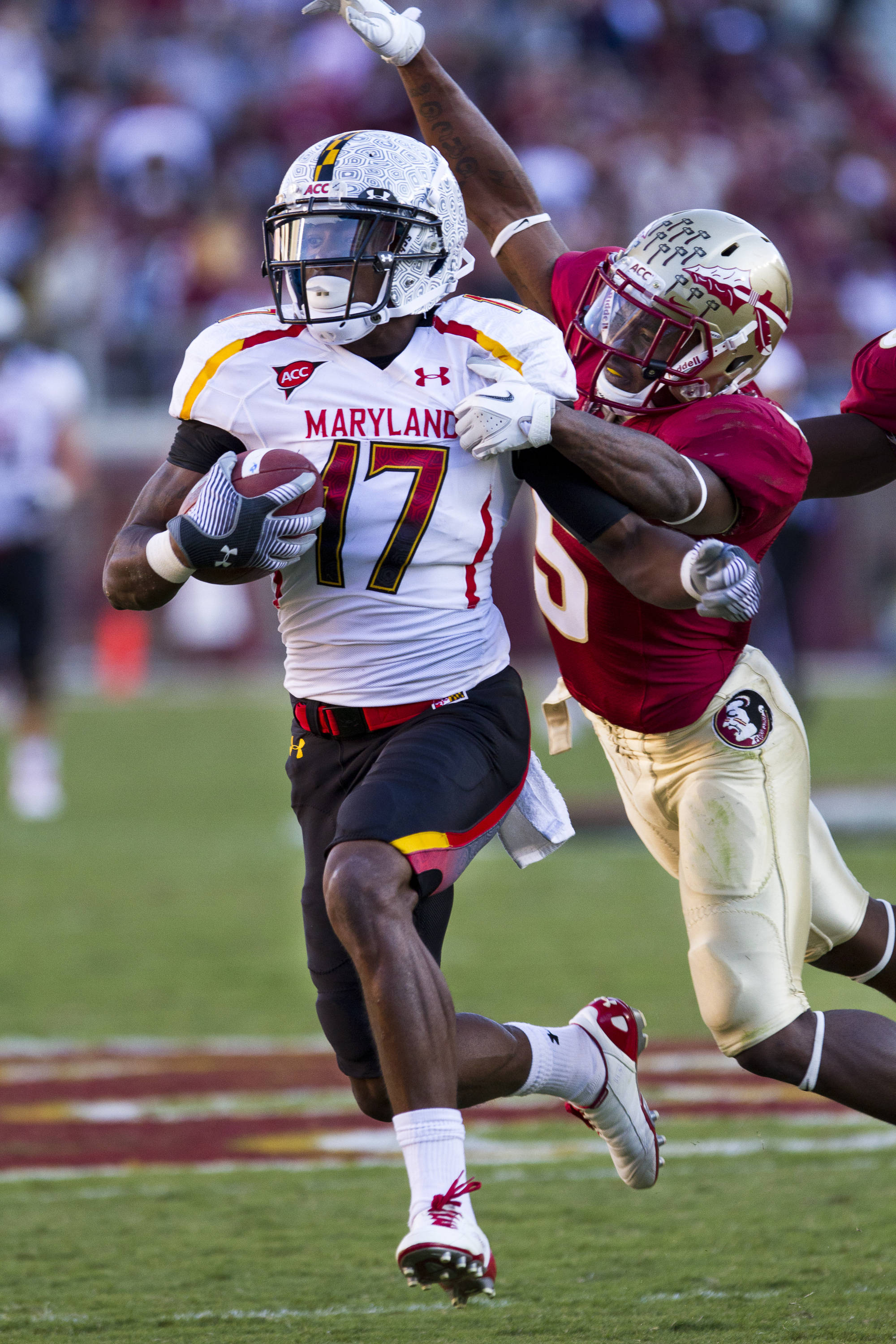 Greg Reid (5) stops a Maryland ball carrier on a breakaway run during the football game against Maryland in Tallahassee, Florida on October 22, 2011.