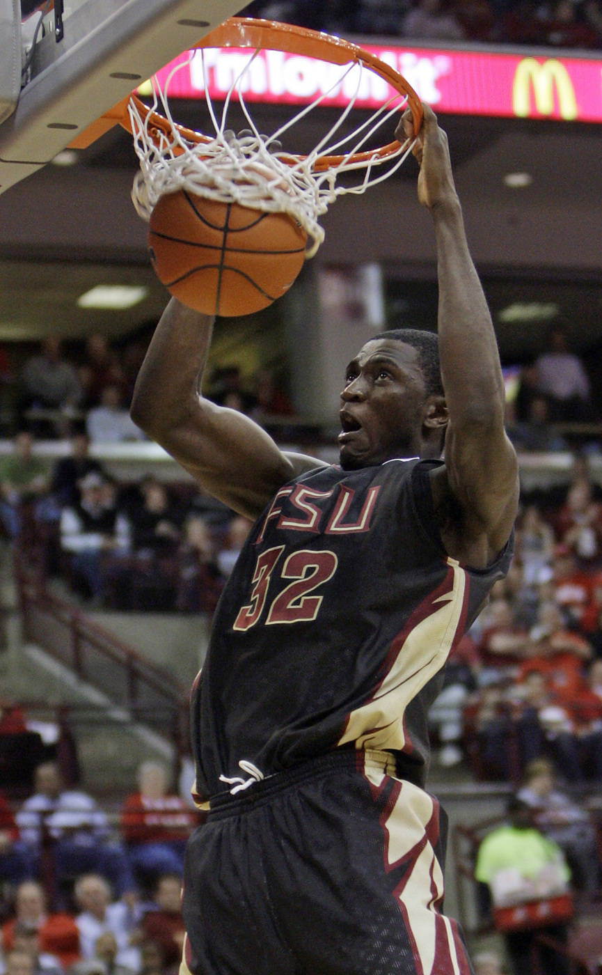 Florida State's Solomon Alabi scores against Ohio State during the first half.