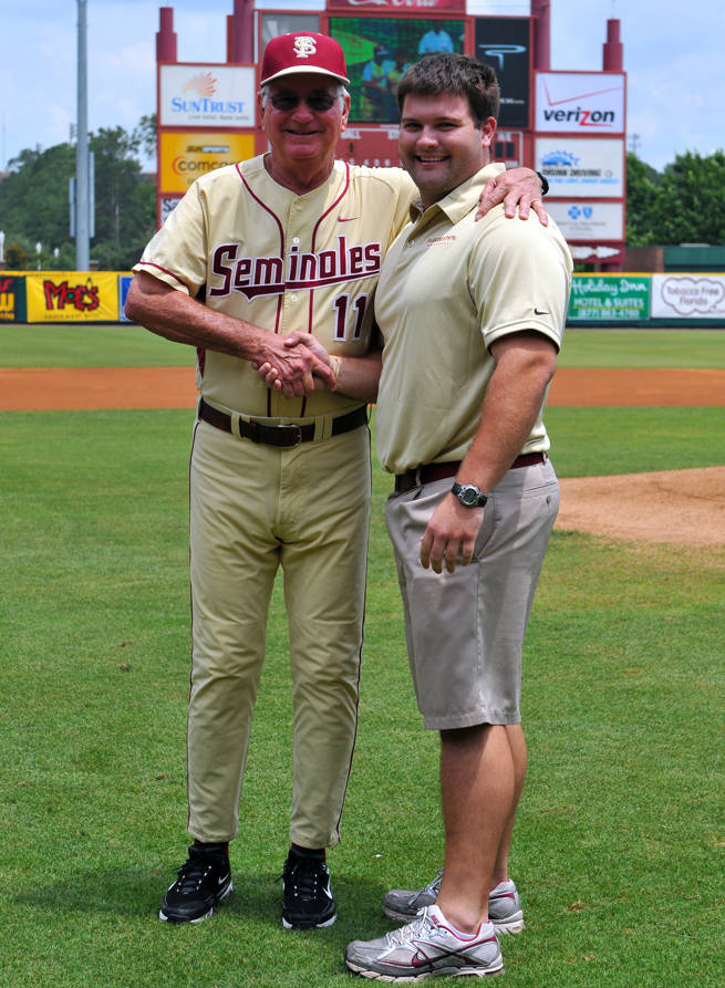 Head coach Mike Martin with athletic training student Brandon Stone.